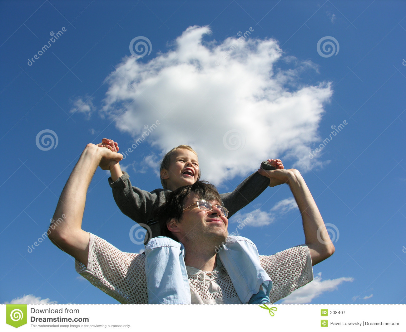Father with son on shoulders sunny day