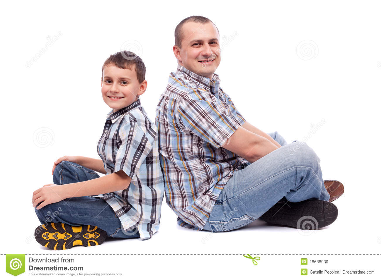 Father and son sitting back to back