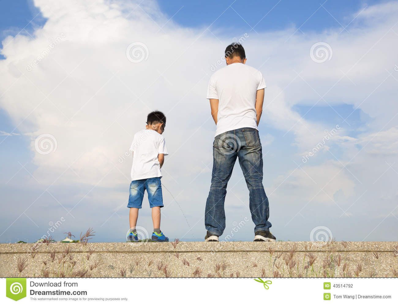 father and son standing on a stone platform and pee together stock photo image of family. Black Bedroom Furniture Sets. Home Design Ideas