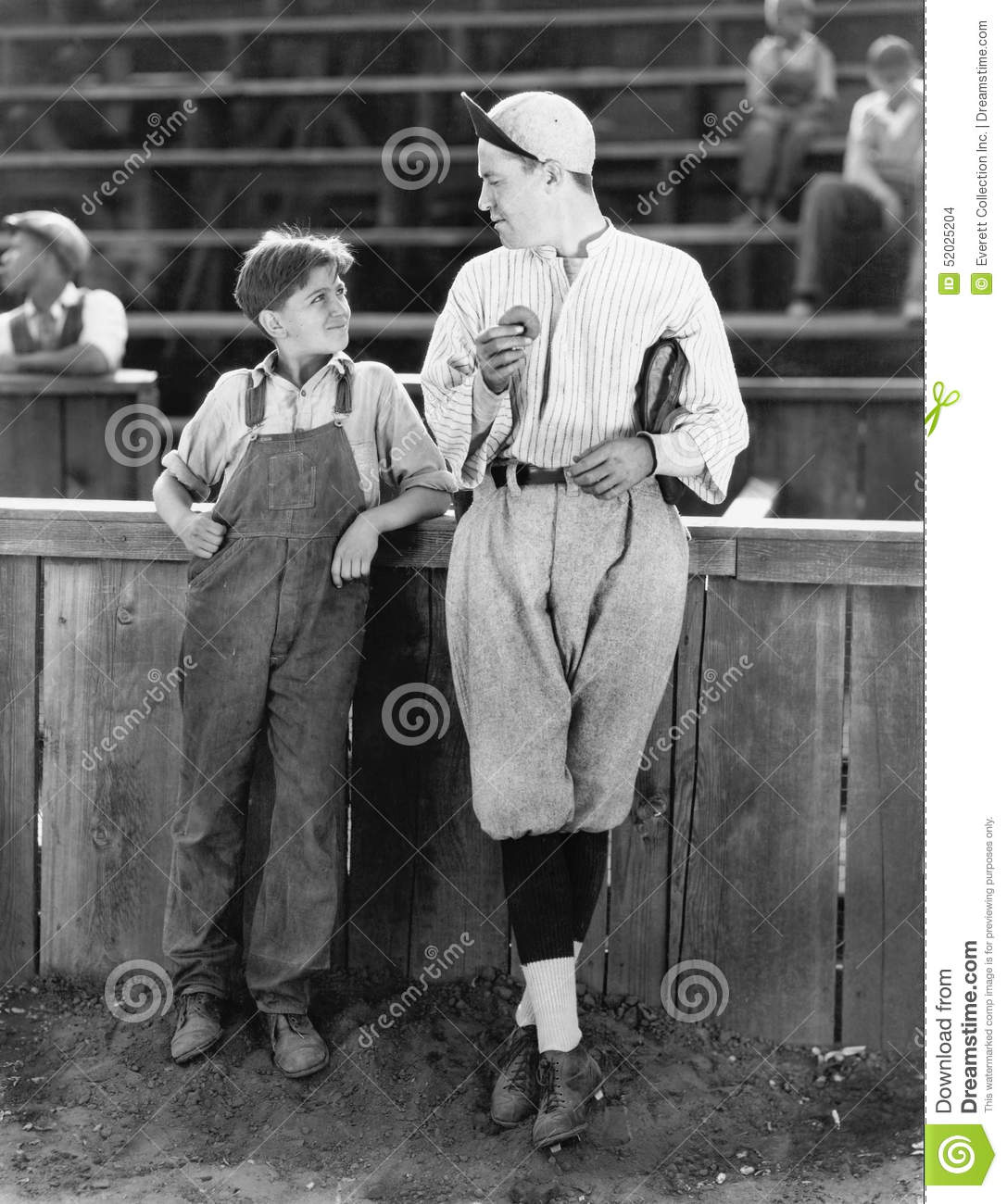 Father and son standing together on a baseball field