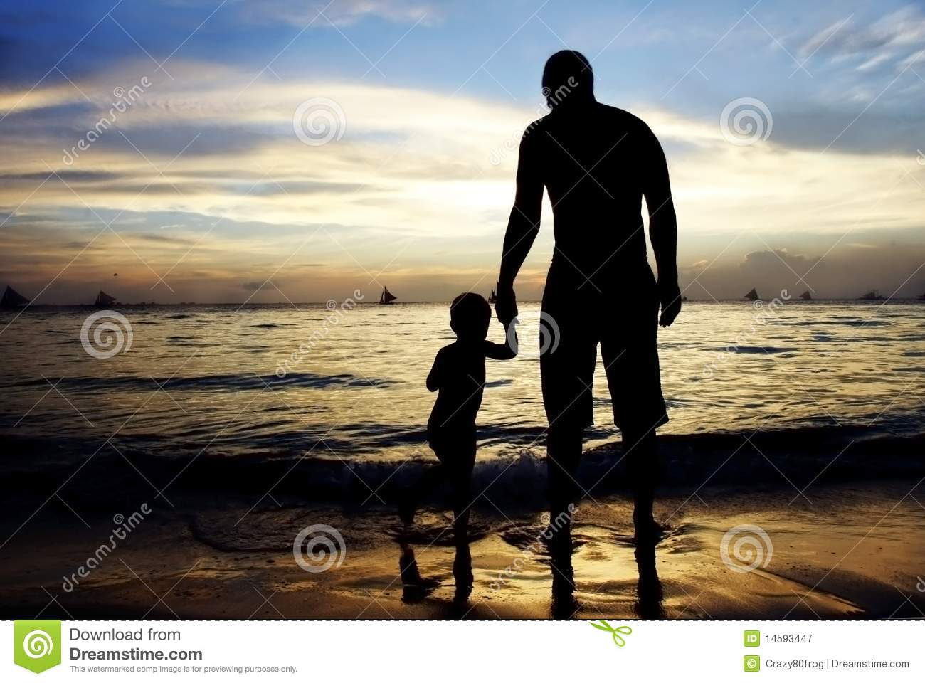 Father And Son On Sunset Sea Background Stock Image