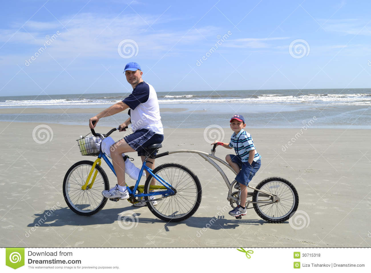 Father and son on alley cat bike at the beach
