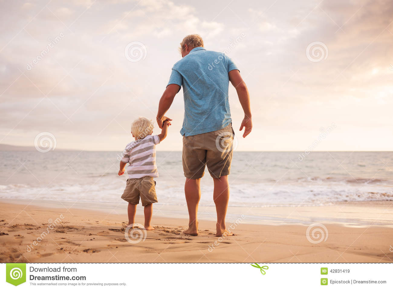 Father and son wallking on the beach