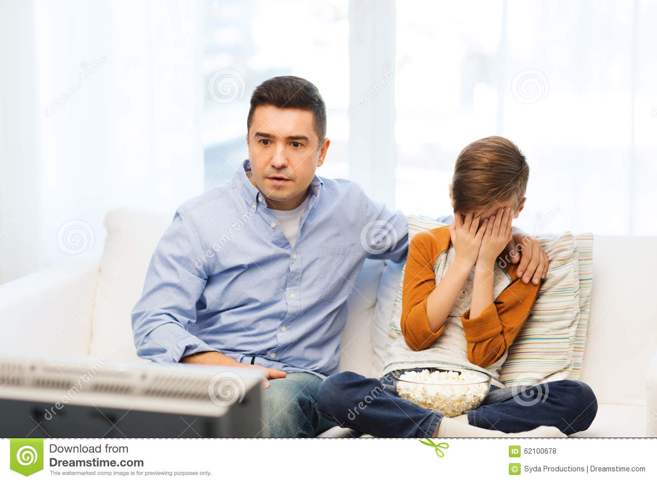 Image result for dad and son watching horror movie
