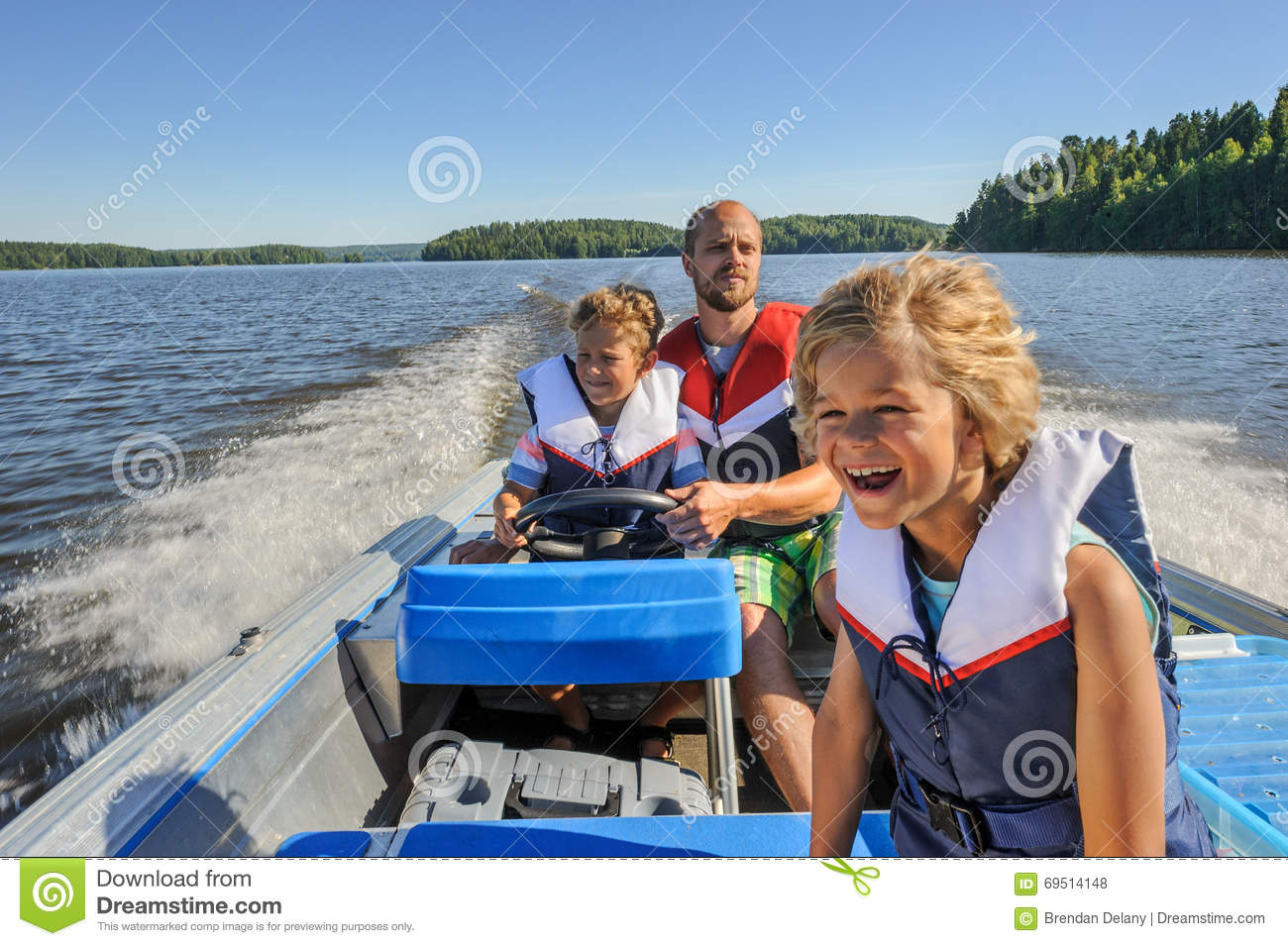 Father and sons boating