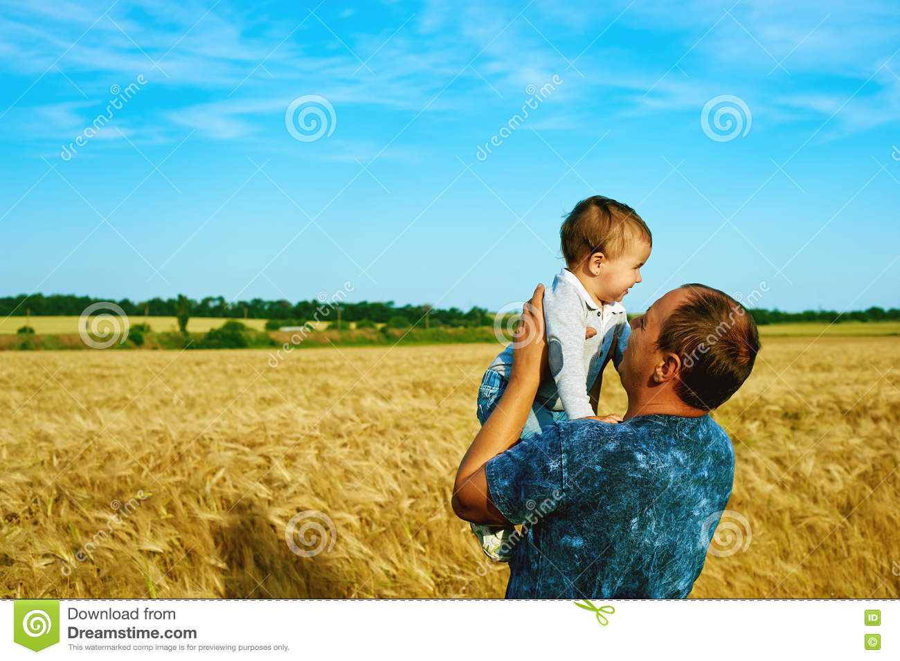 The father is talking to his daughter Happy smiling child with the parent. Family portrait.Father s day