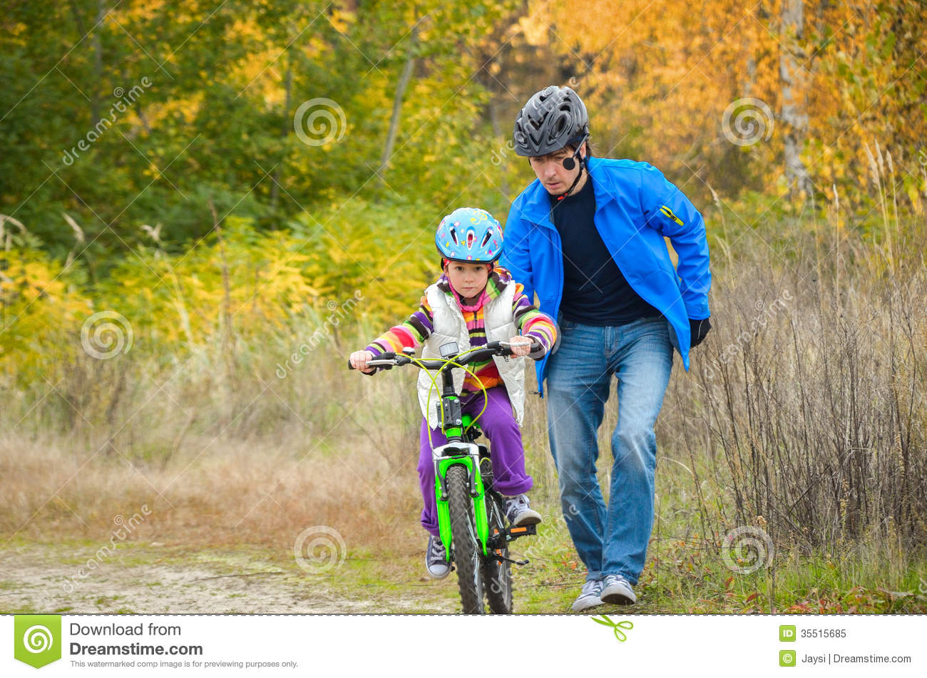 Father Teaching Child To Ride Bike Royalty Free Stock ...