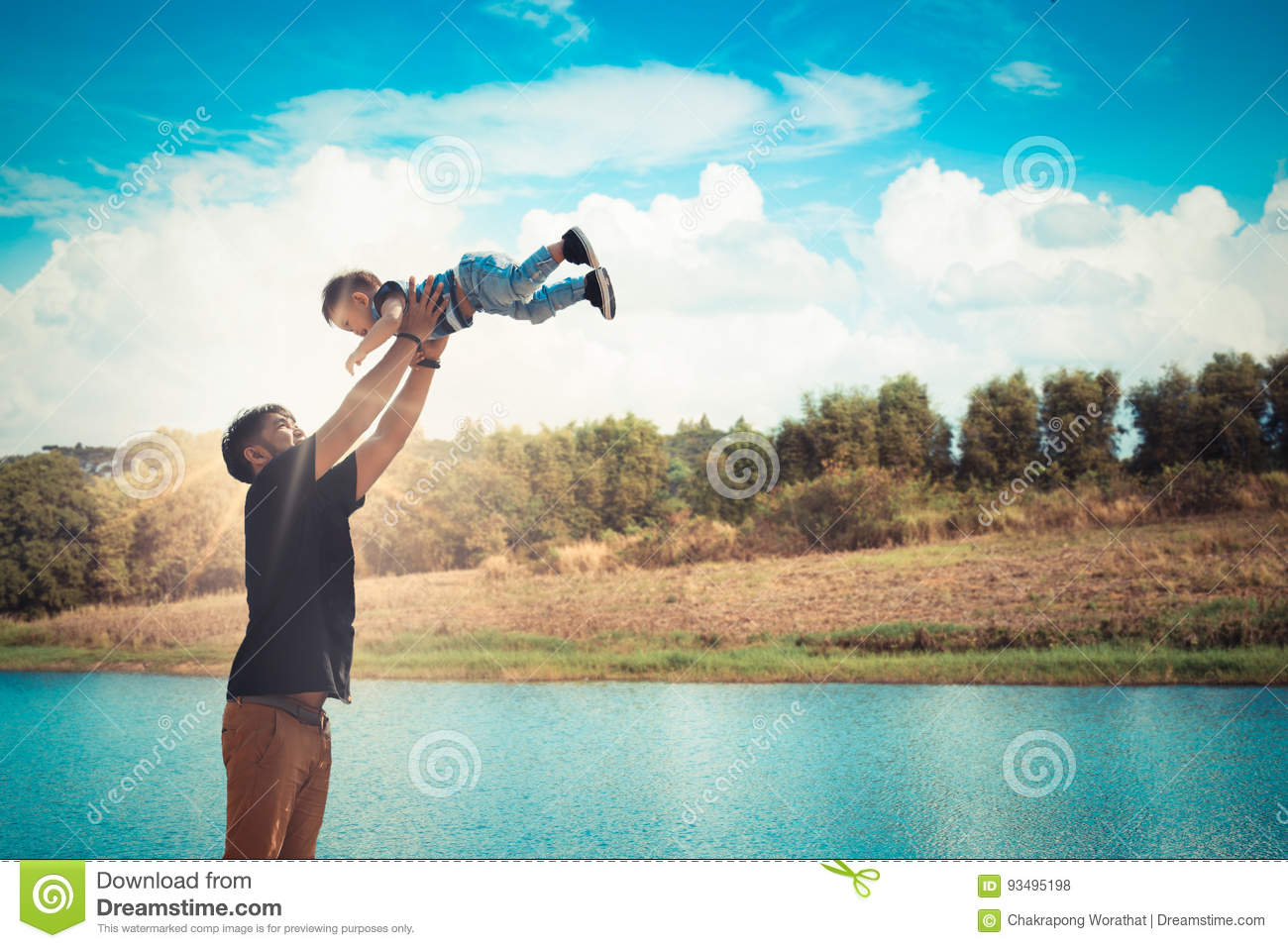 father throwing his son in the air and catching hi royalty