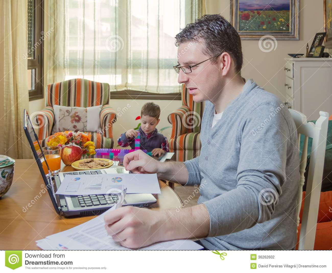 royalty free stock photo download father working in home office - Working In Home Office