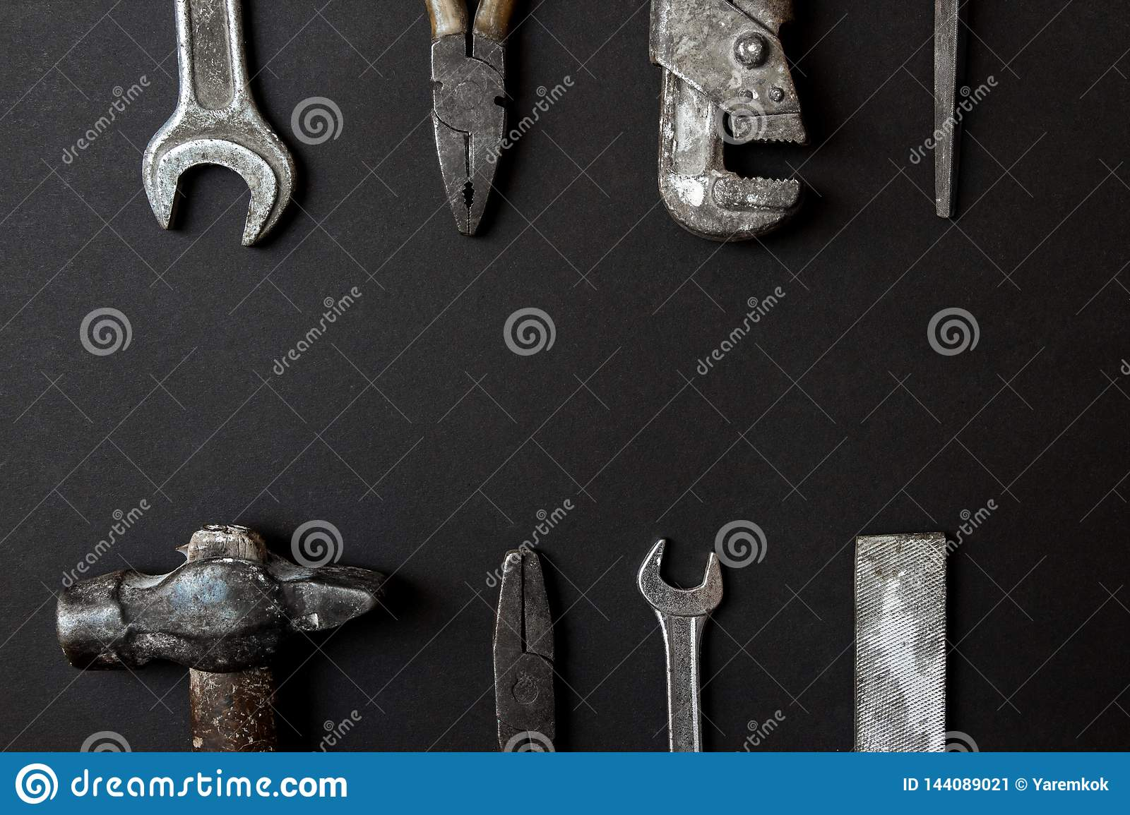 Fathers day greeting card concept. Vintage old tools on black paper background. Flat lay. Copy space