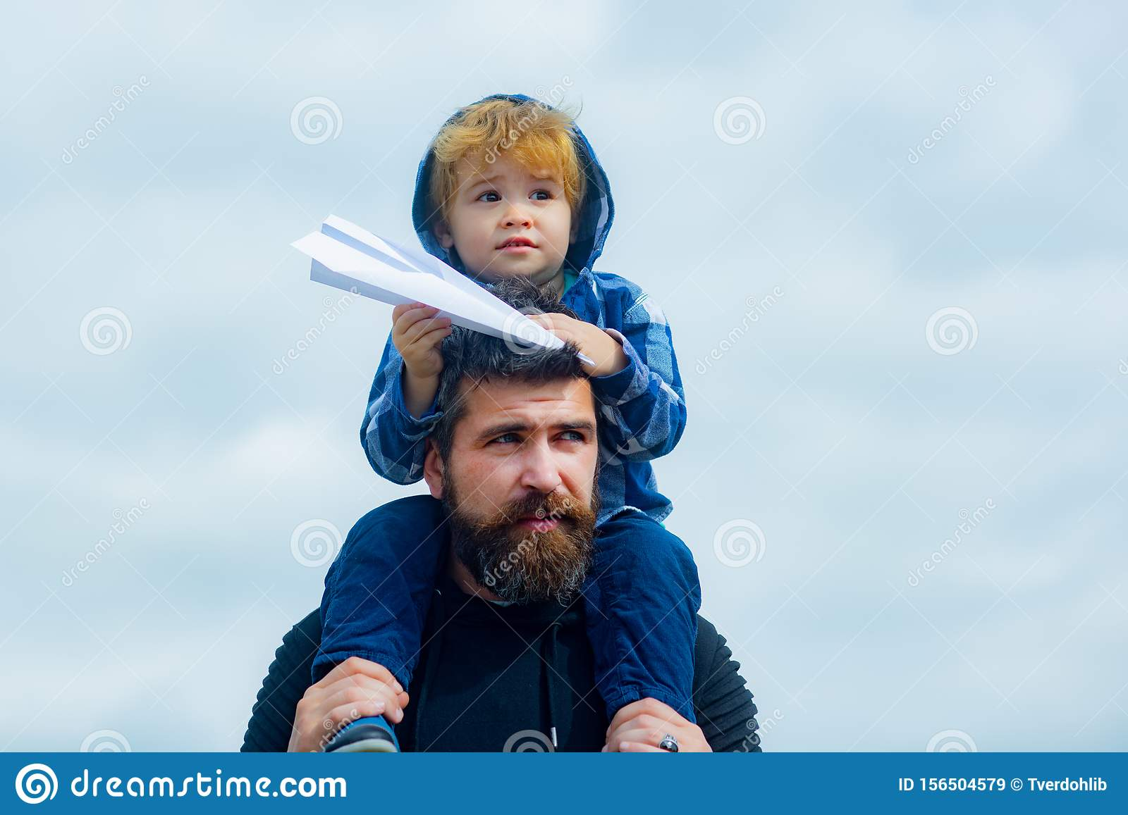 Fathers day. Happy father giving son back ride on sky in summer. Family Time. Dream of flying.