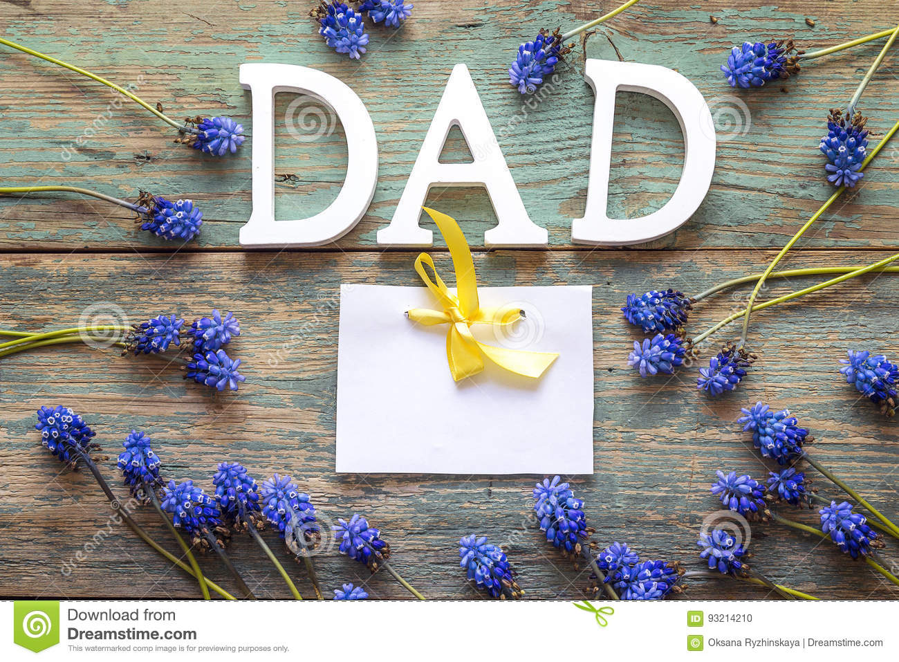 fathers day message with blank paper card and blue flowers on o