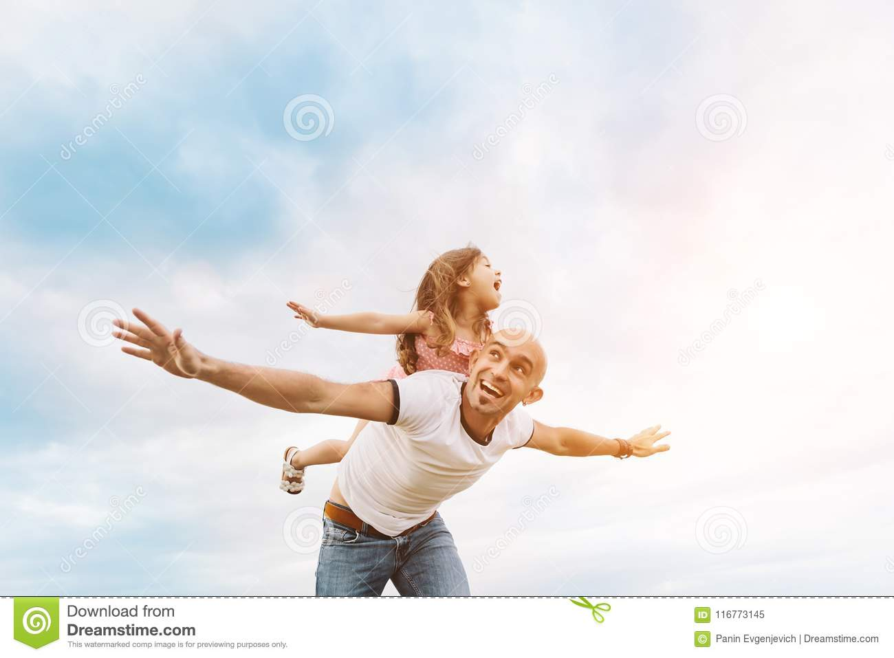 Fathrer and cute daughter playing like airplane