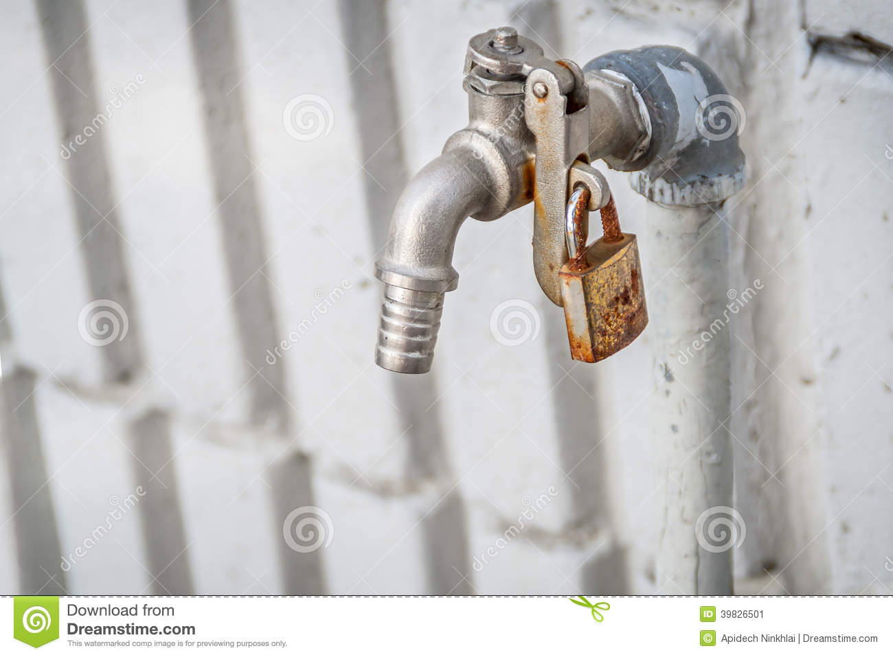 Faucet with key lock stock image. Image of conceptual - 39826501