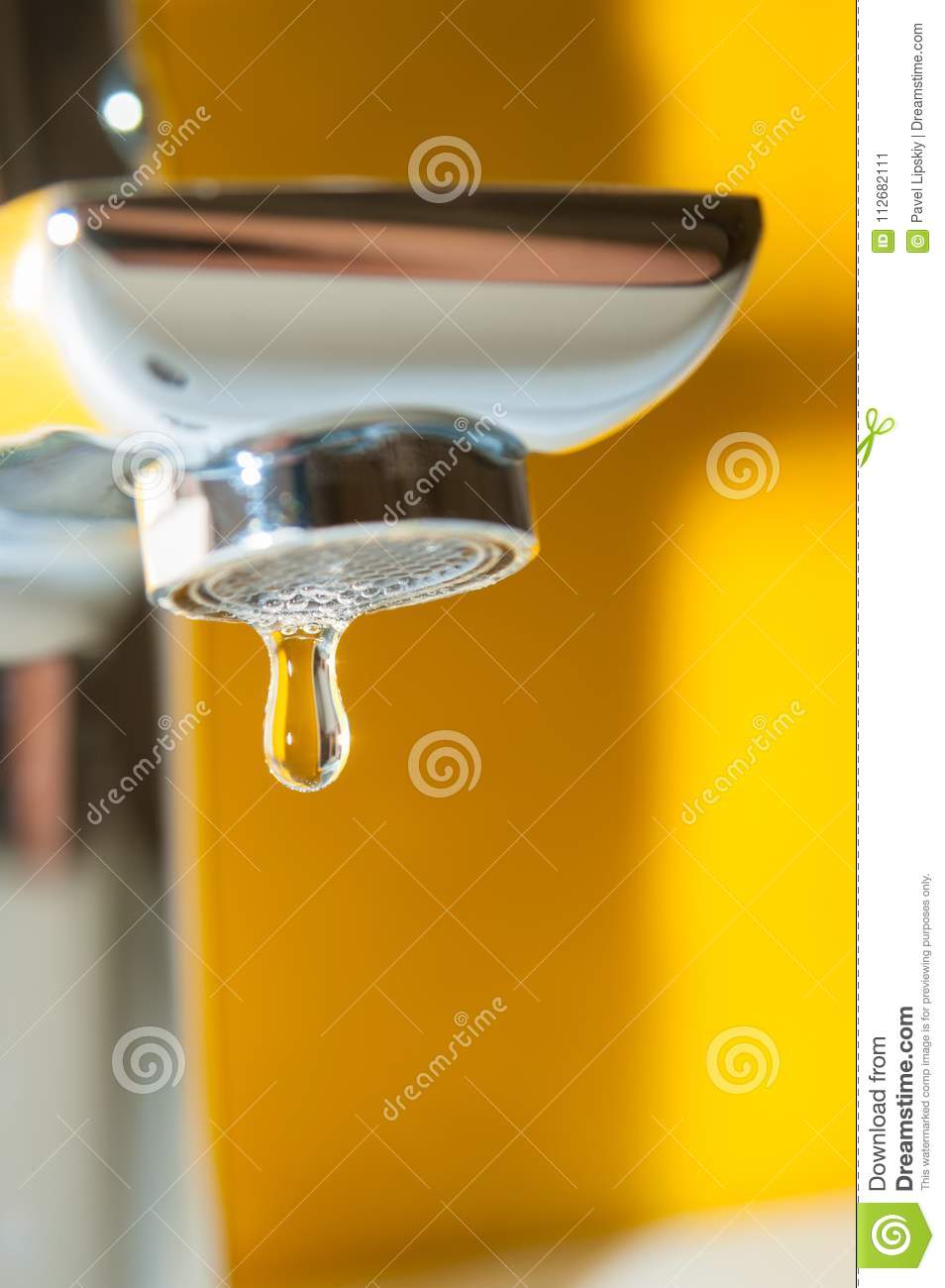Faucet With Water Drop On Yellow Background Stock Image - Image of ...