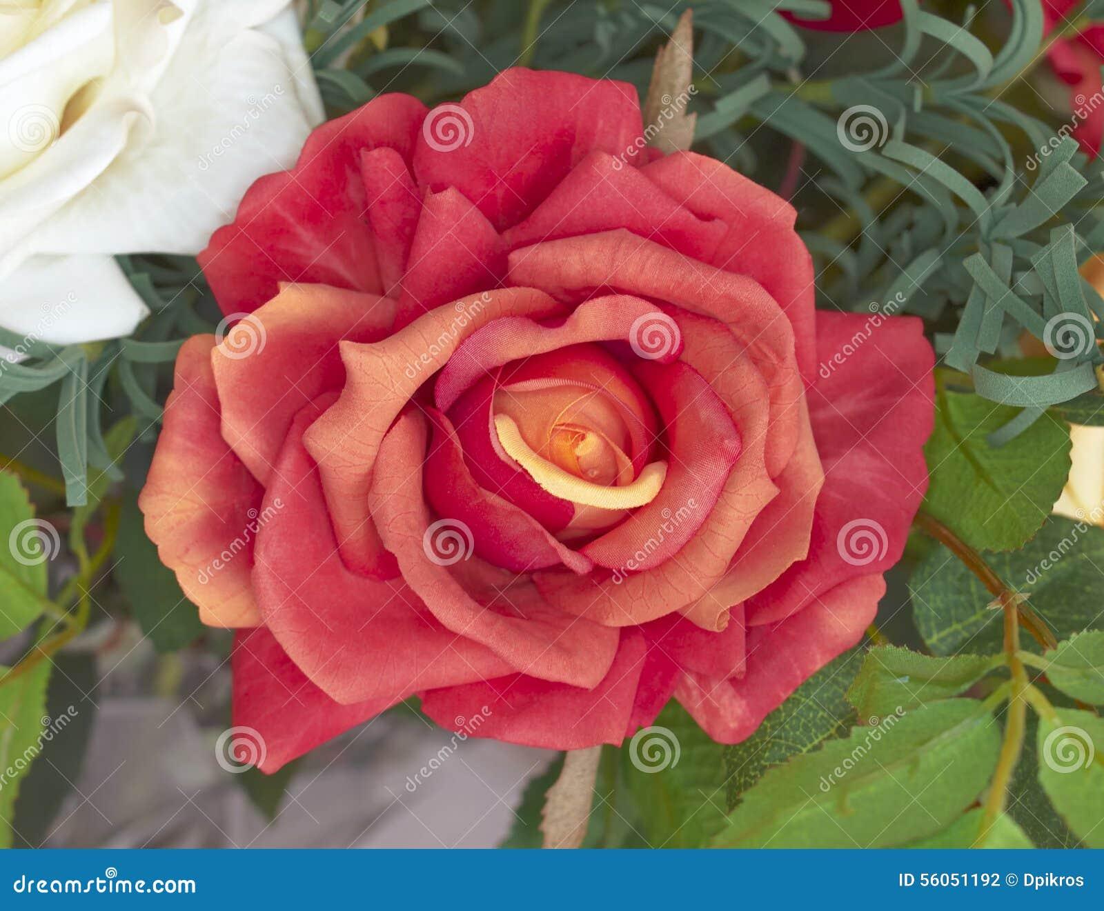 fausse fleur rose orange-foncé photo stock - image: 56051192