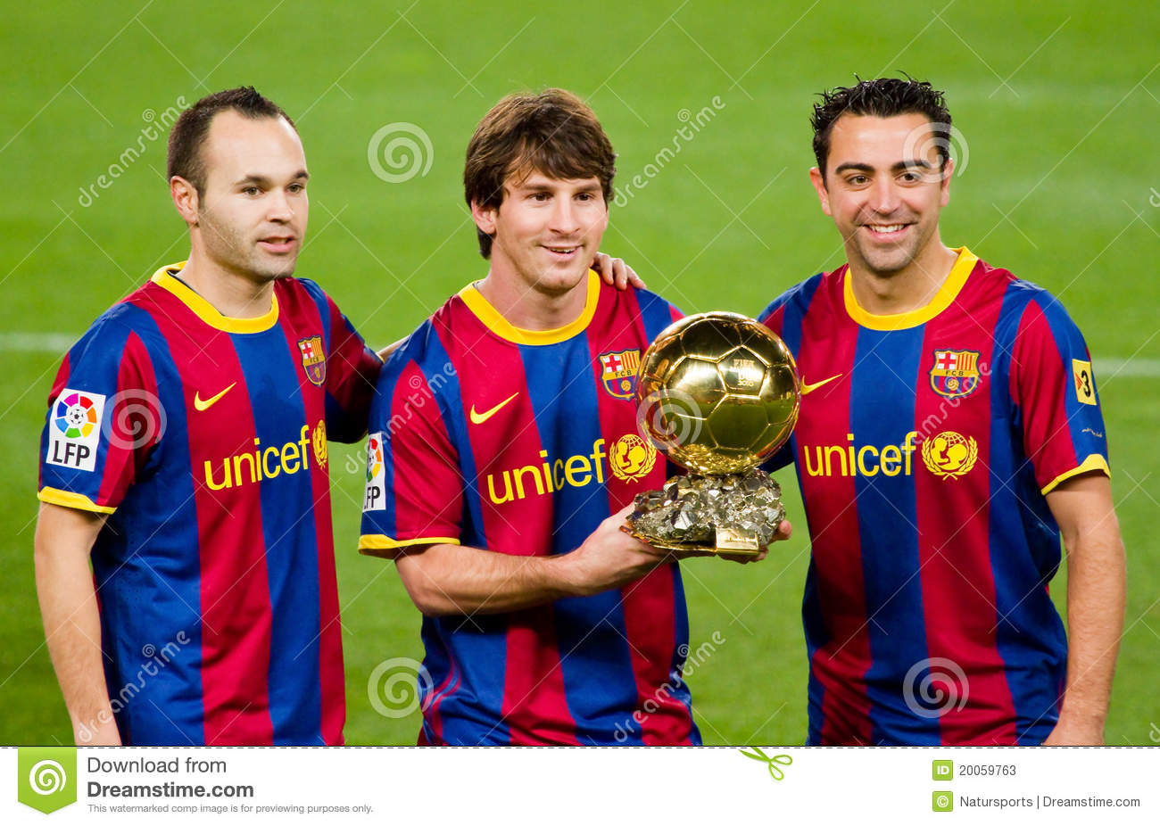 and Xavi offering the FIFA World Player Gold Ball Award to the soccer ...