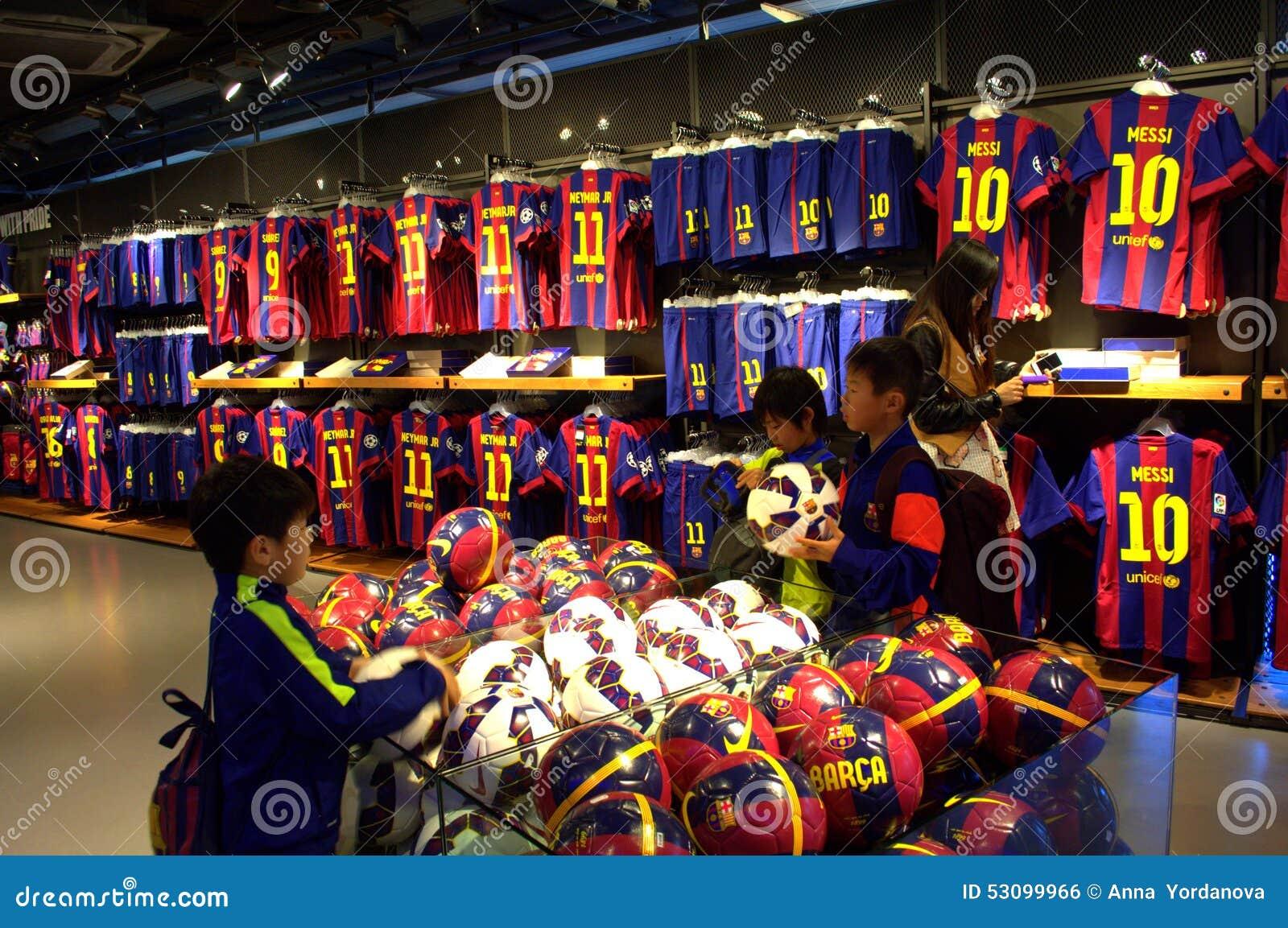 36910e9c7 Boys fans Inside the official store of football club Barcelona. Camp Nou  stadium.