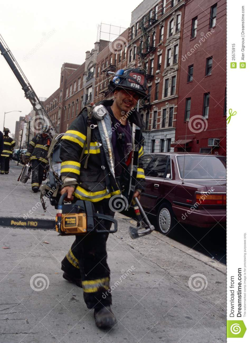 FDNY Firefighter Carrying Tools And Equipment In New York ...