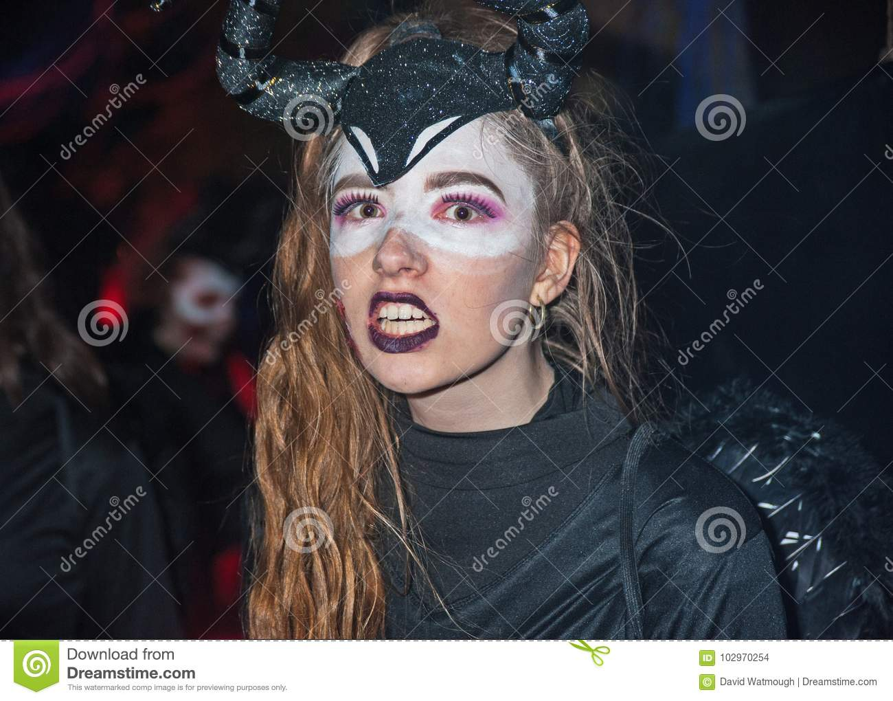 woman in black with horns snarling in the presence of ghosts and ghouls at halloween on 28th october 2017 at ness islands halloween festival