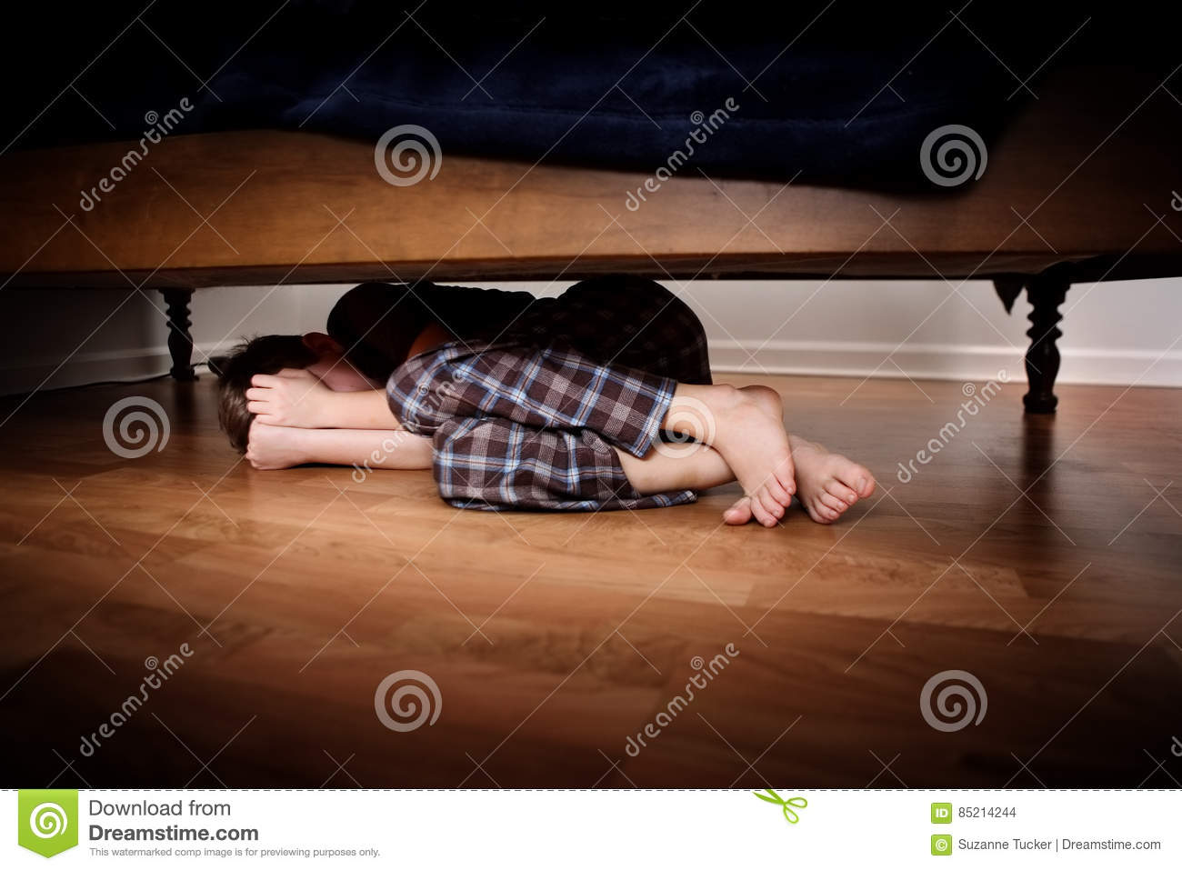 Fearful Boy Hiding Under The Bed Stock Photo Image Of Defeated