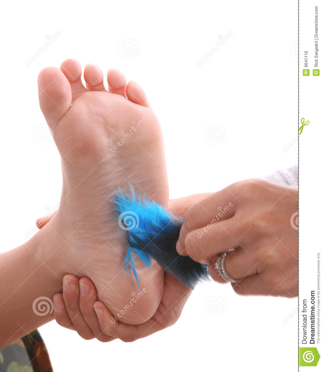Feathers tickling childs foot