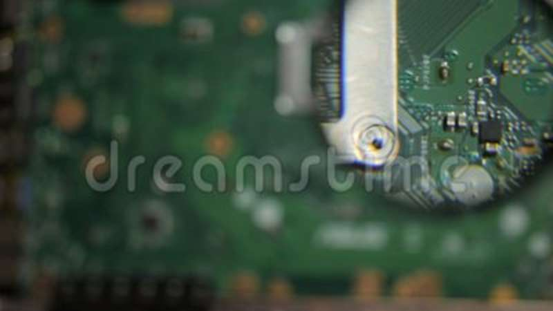 Features test laptop motherboard with a magnifying glass