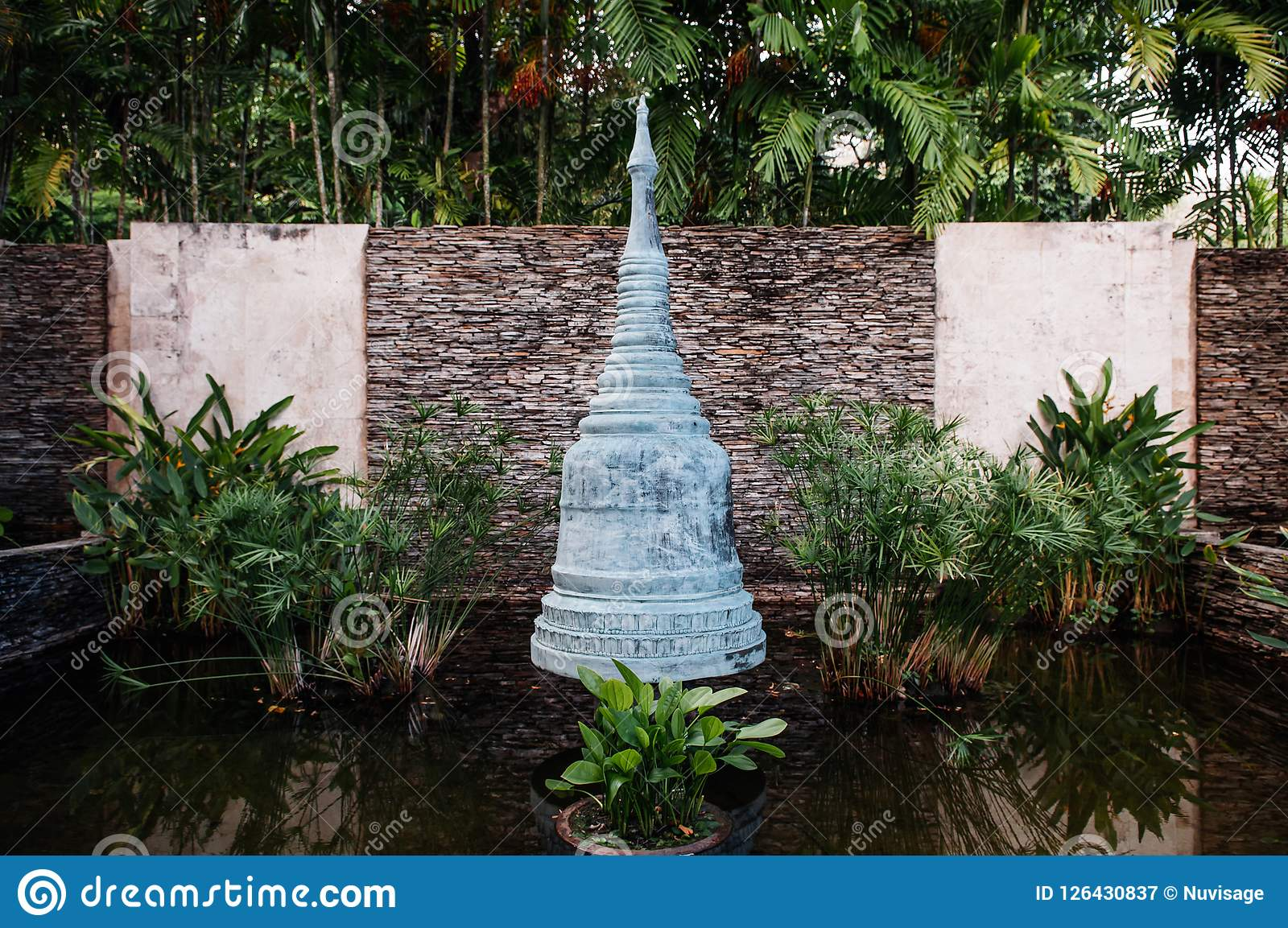 Bronze Pagoda Sculpture In Water Pond Thai Garden Landscape