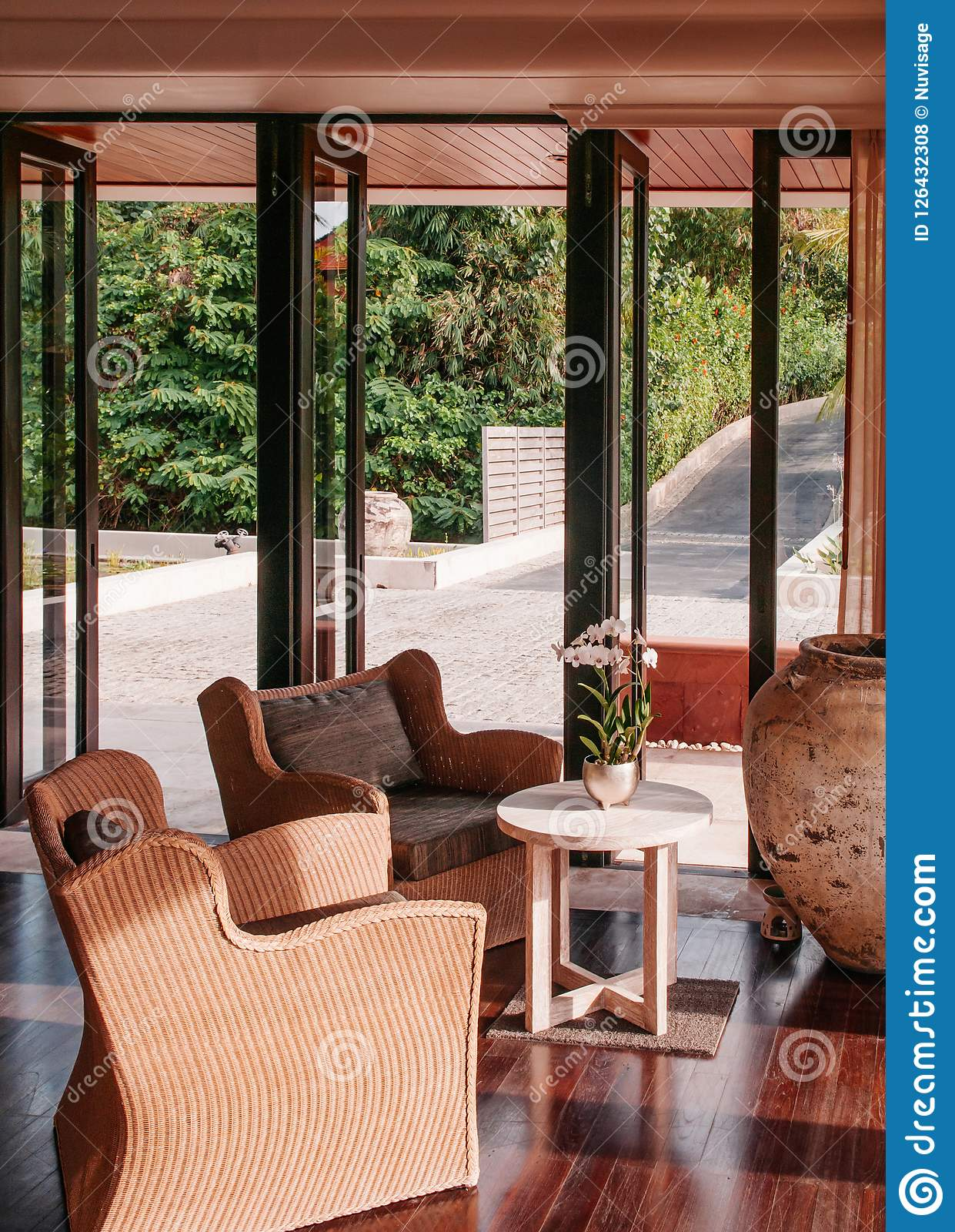 Contemporary Colonial Style Living Room With Vintage Rattan Chairs And Coffee Table Editorial Stock Photo Image Of Indoor Apartment 126432308