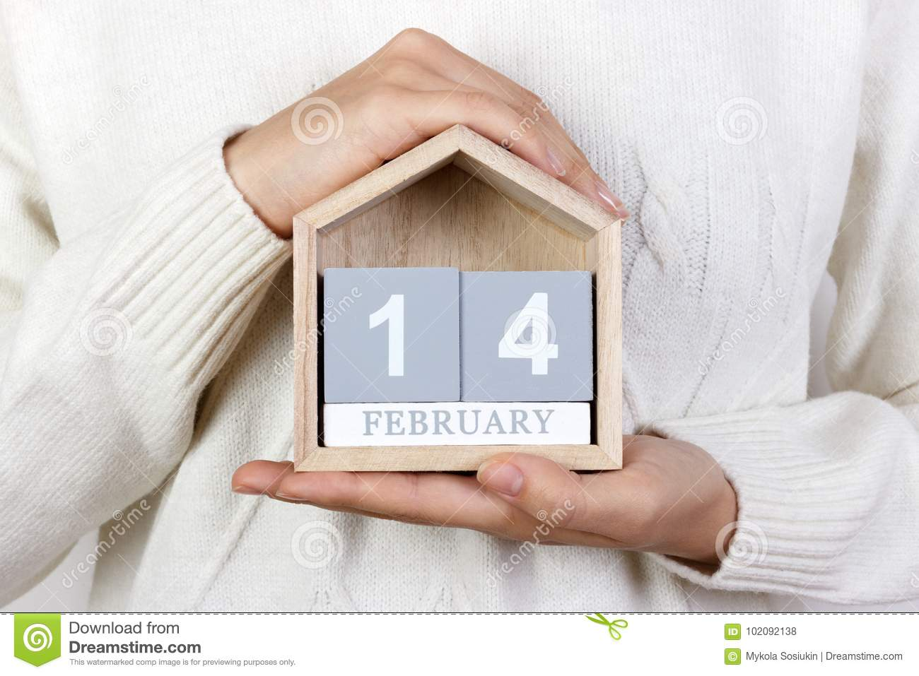 February 14 In The Calendar The Girl Is Holding A Wooden Calendar
