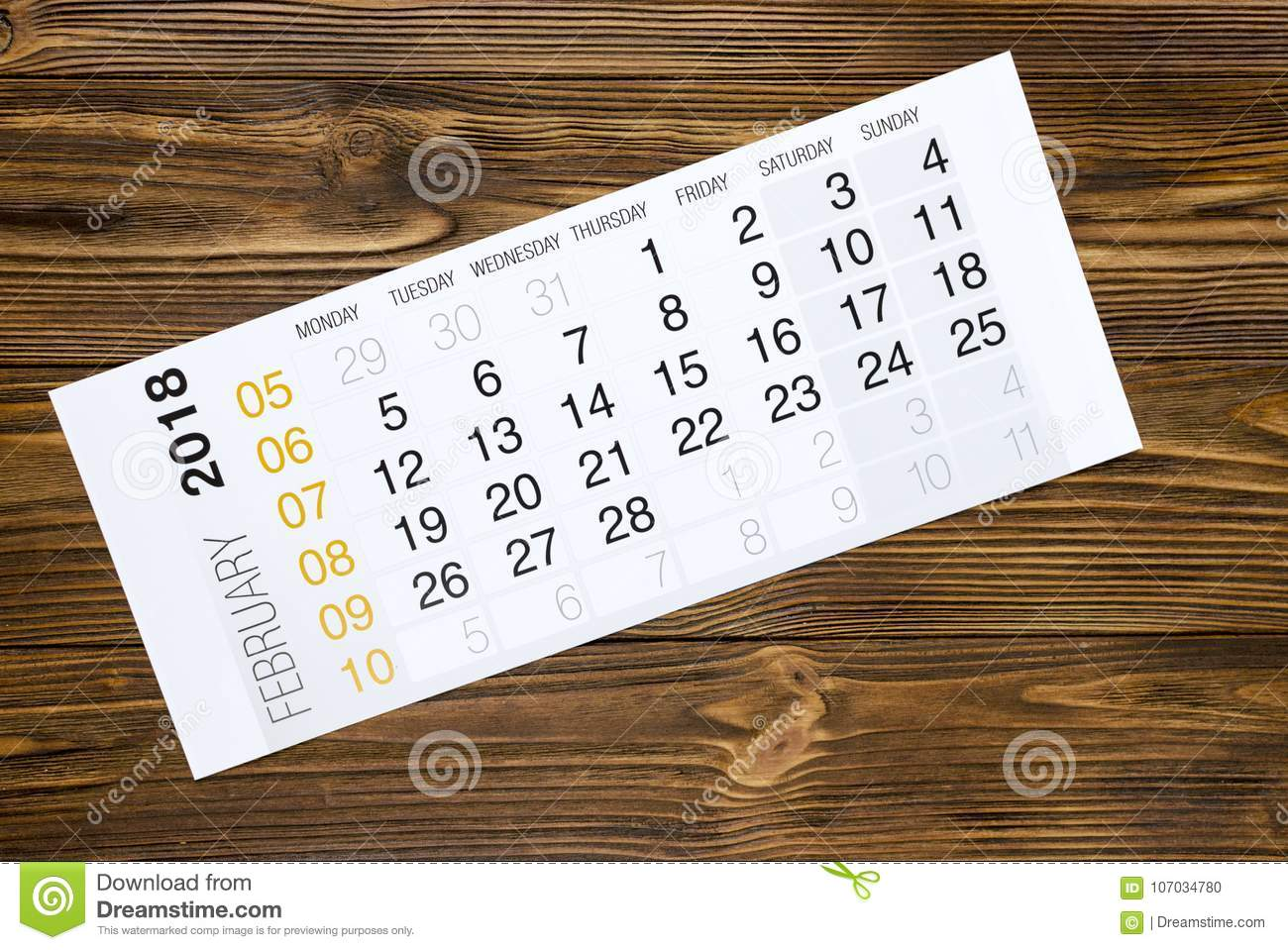 february 2018 calendar on wooden table