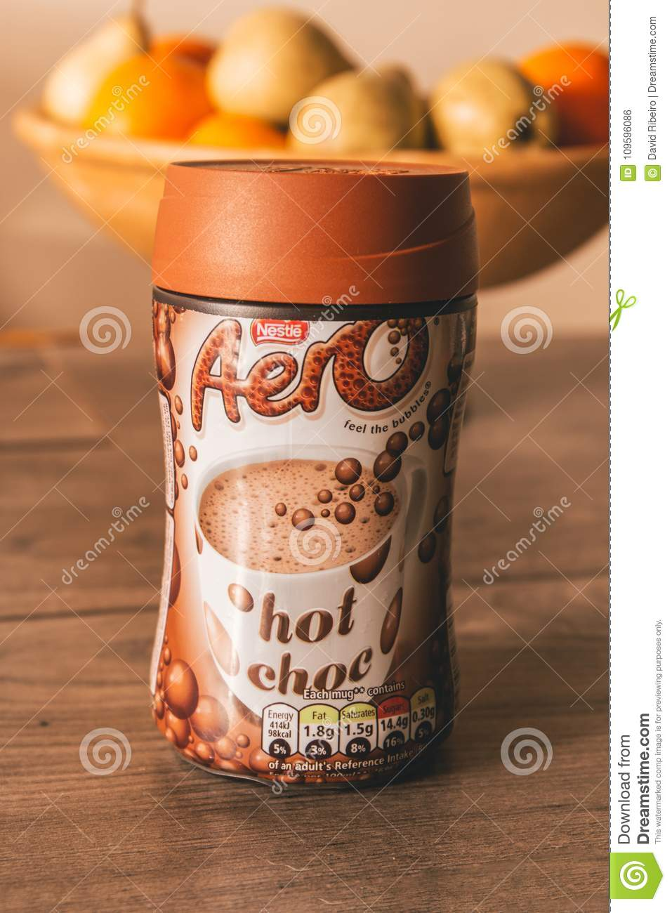 Nestlé Aero Hot Chocolate Container On Top Of A Wooden Table