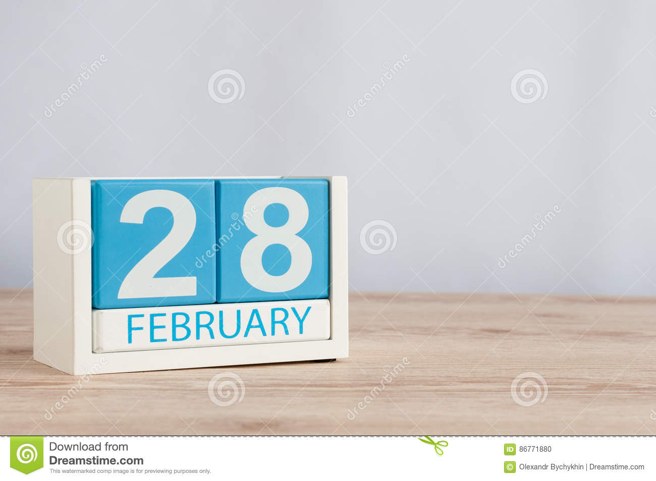 February 28th. Cube calendar for february 28 on wooden surface with empty space For text. Not Leap year or intercalary