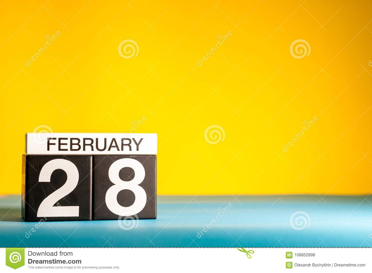day 28 of february month calendar on yellow background winter
