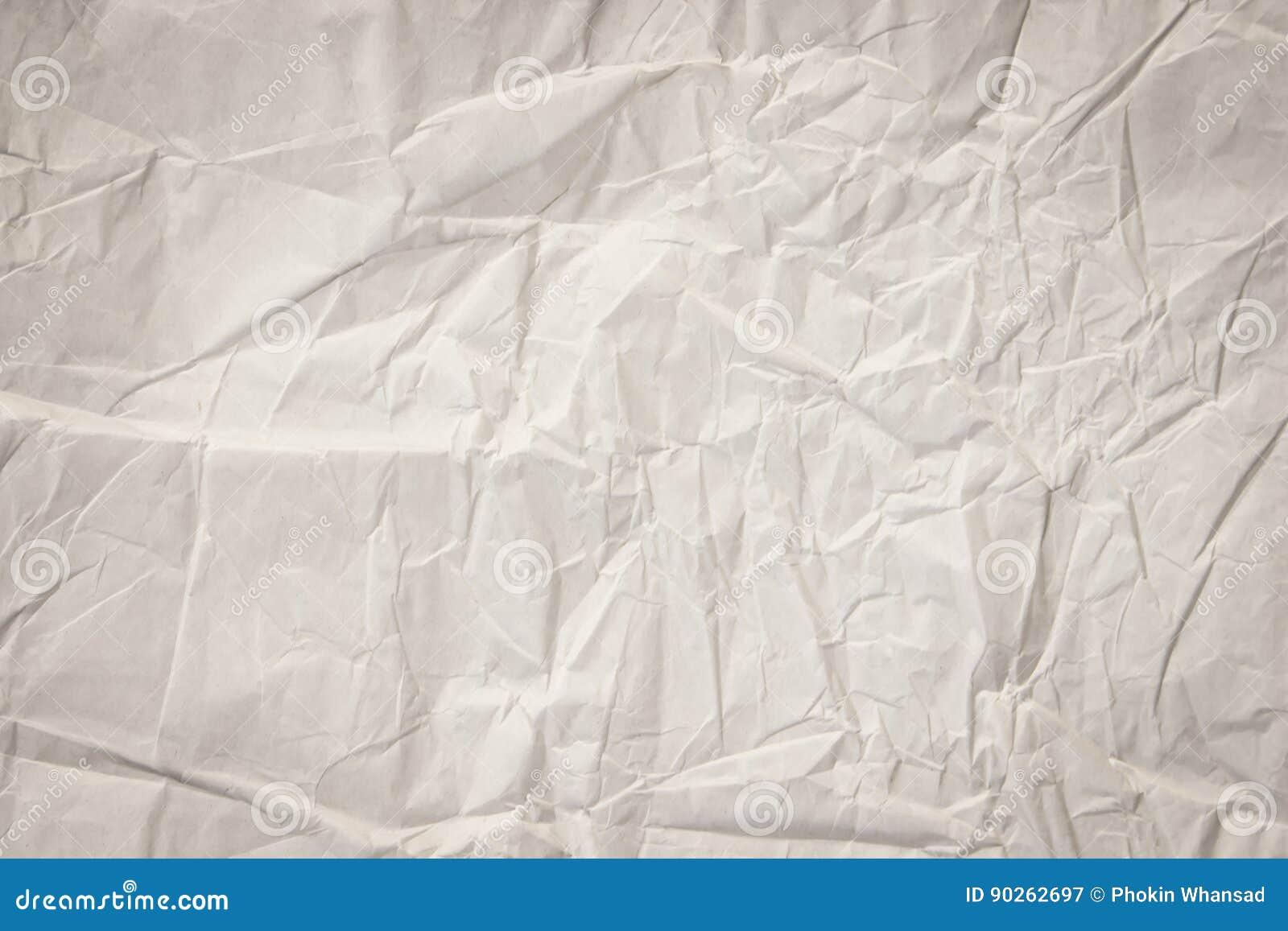 Feche acima da folha brilhante do papel da textura do enrugamento a luz tonificou a arte