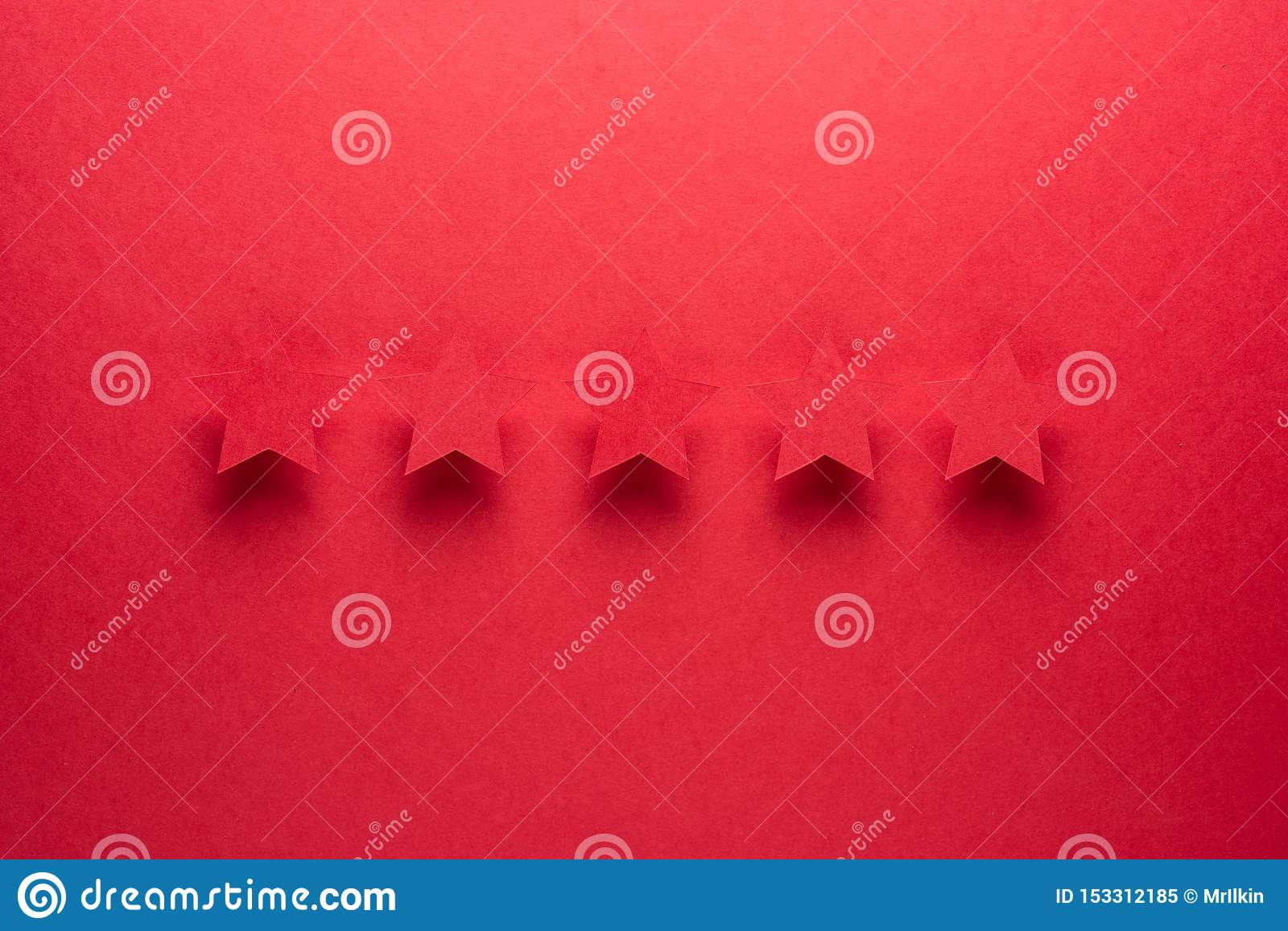 Feedback concept. Five red paper stars of approval on a red background.