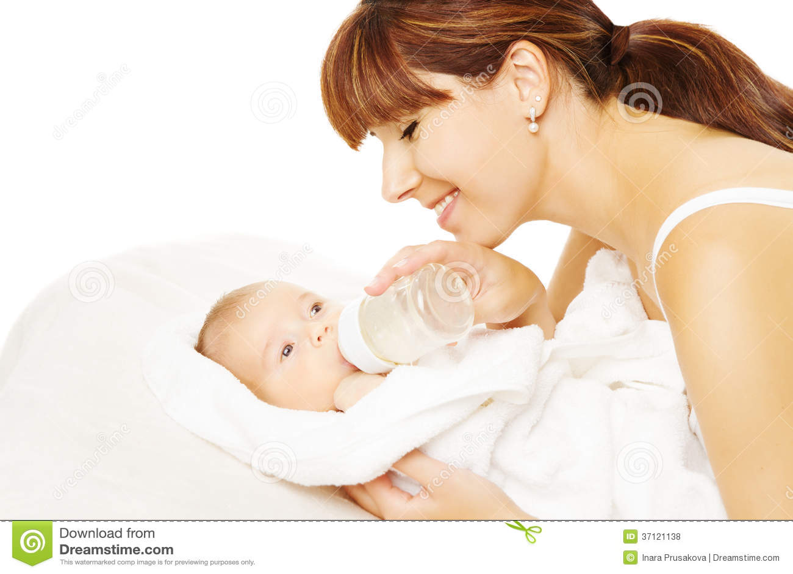 feeding baby  newborn eating milk from bottle  royalty
