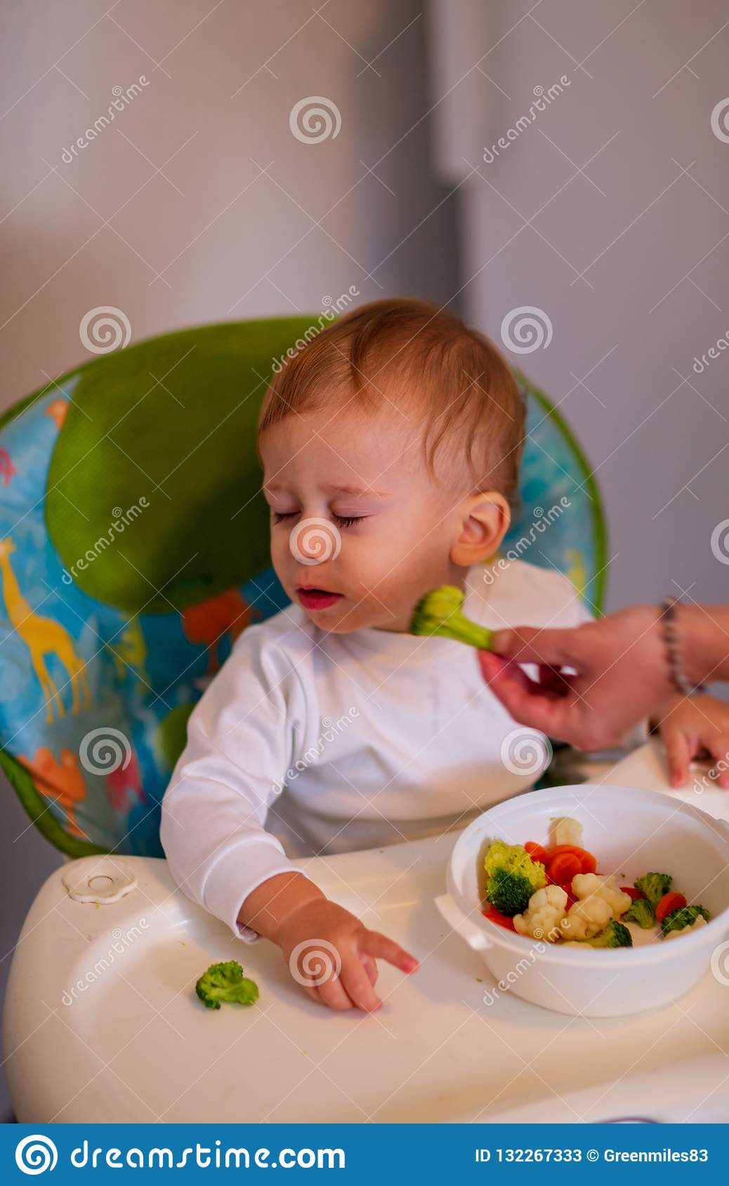 Feeding baby with vegetables -Beautiful baby refuses to eat broc