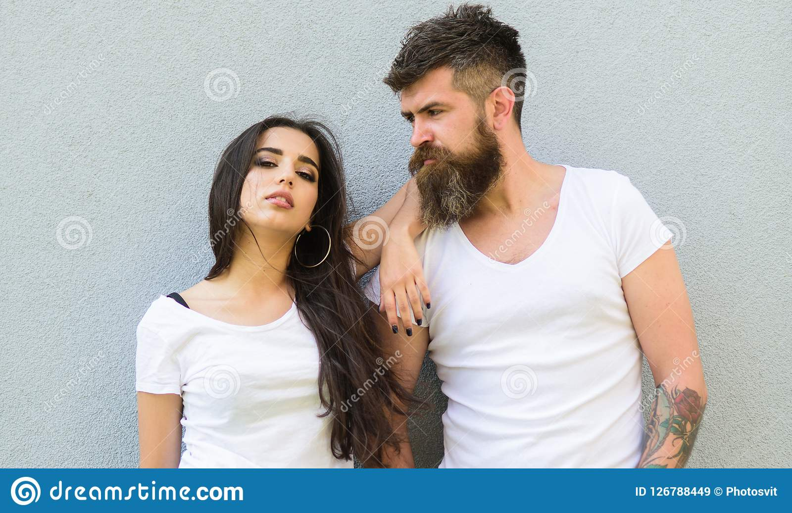 Feel their style couple white shirts cuddle each other hipster bearded and stylish girl