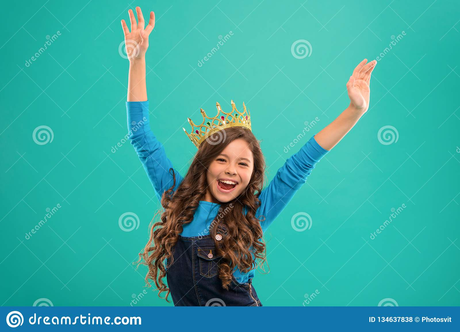 Feels like queen kid wear golden crown symbol of princess lady little princess girl cute baby wear crown while stand blue background childhood concept