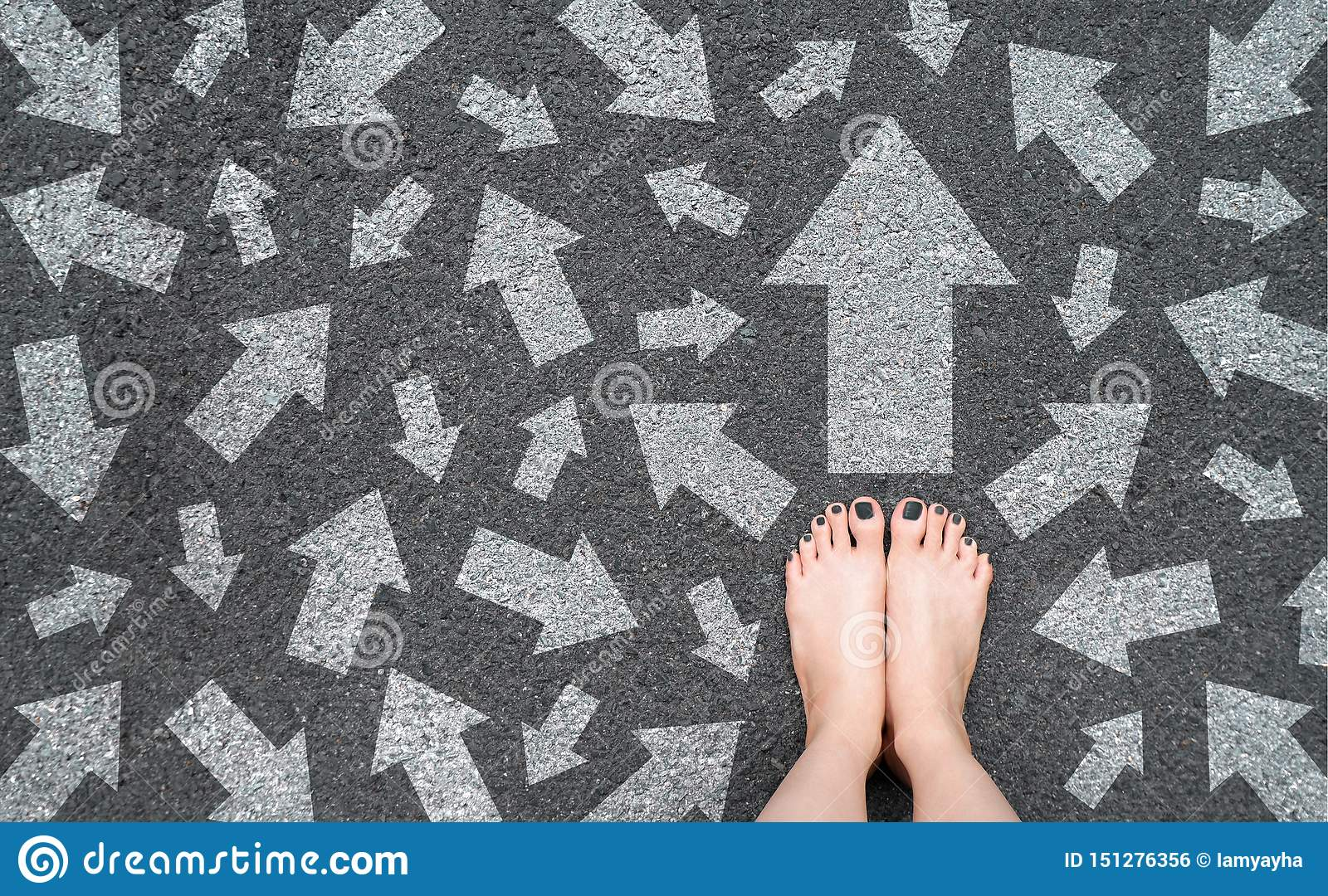 Feet and Arrows on Road. White Arrow Choice Concept. Woman Bare Feet with Gray Nail Polish Manicure Standing on Grunge Concrete
