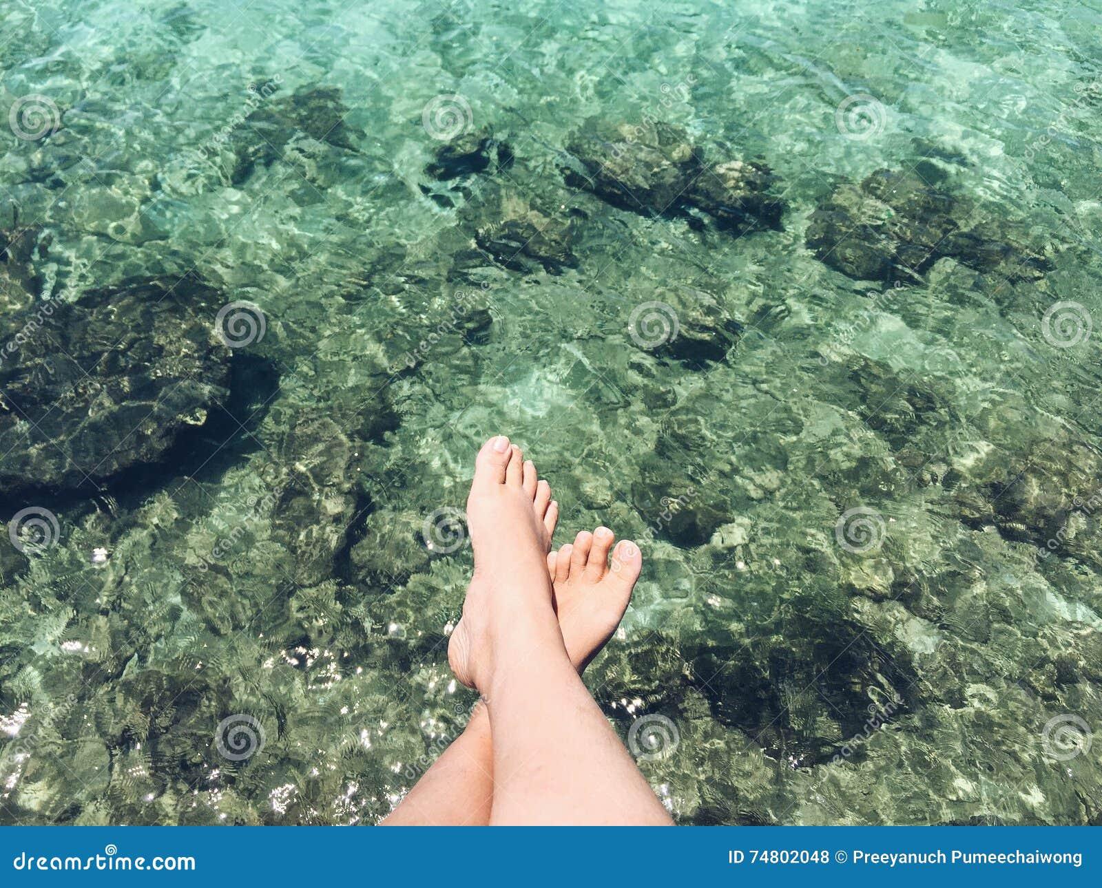 Feet dangling above water