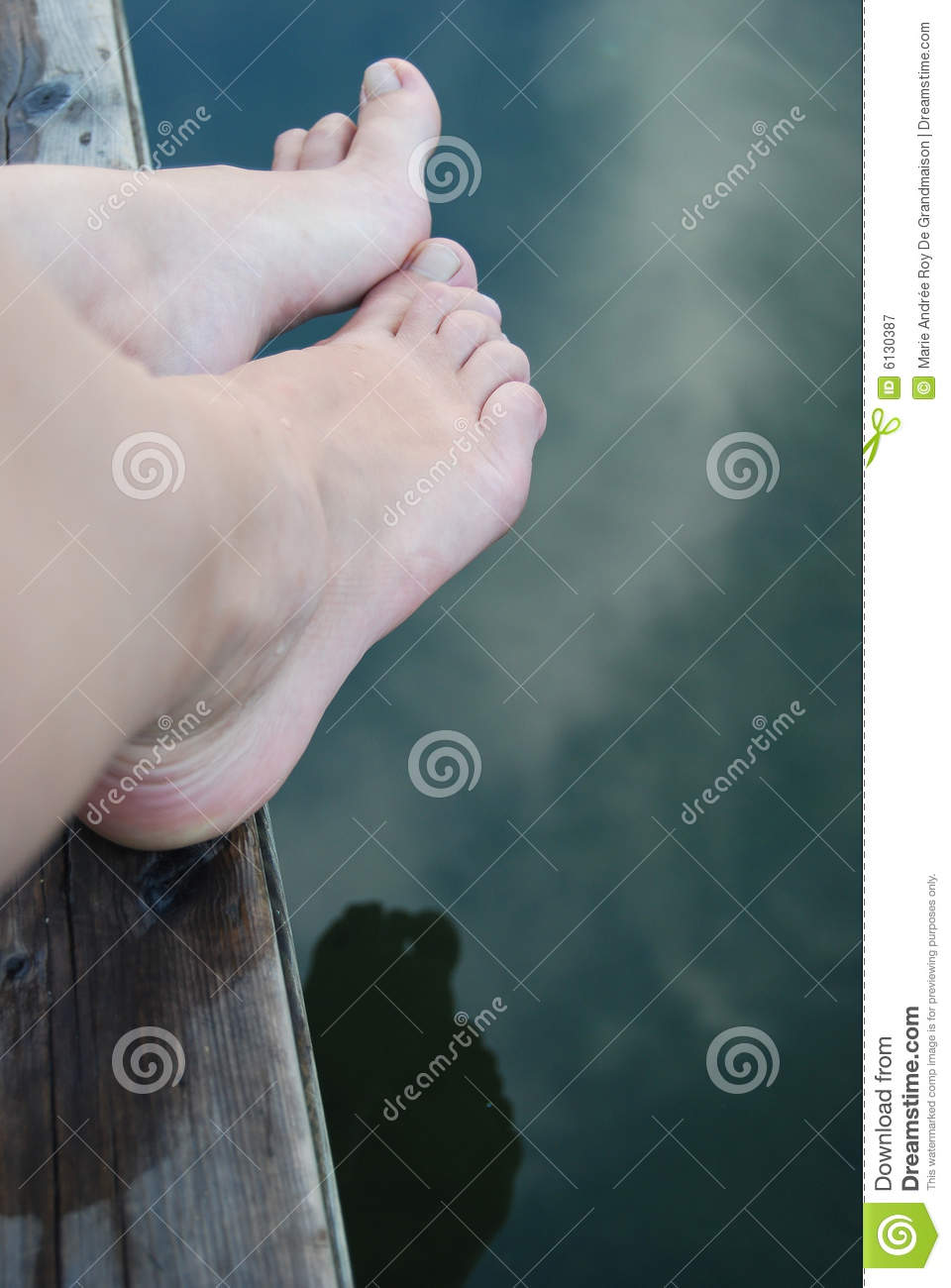Feet by edge of water