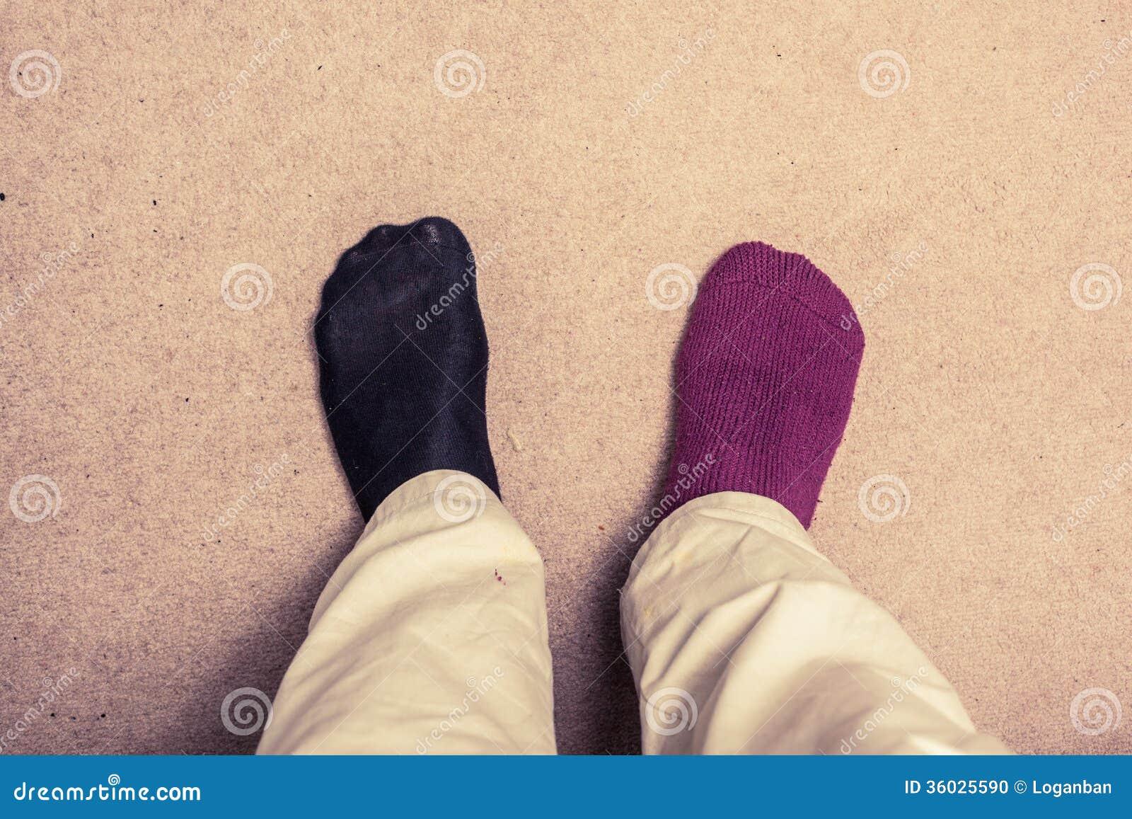 Feet With Odd Socks On Carpet Stock Photo Image 36025590