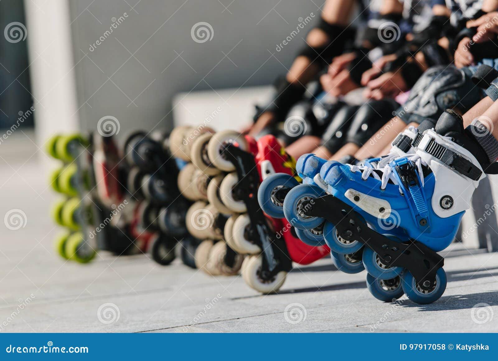 Feet Of Rollerbladers Wearing Inline Roller Skates Sitting