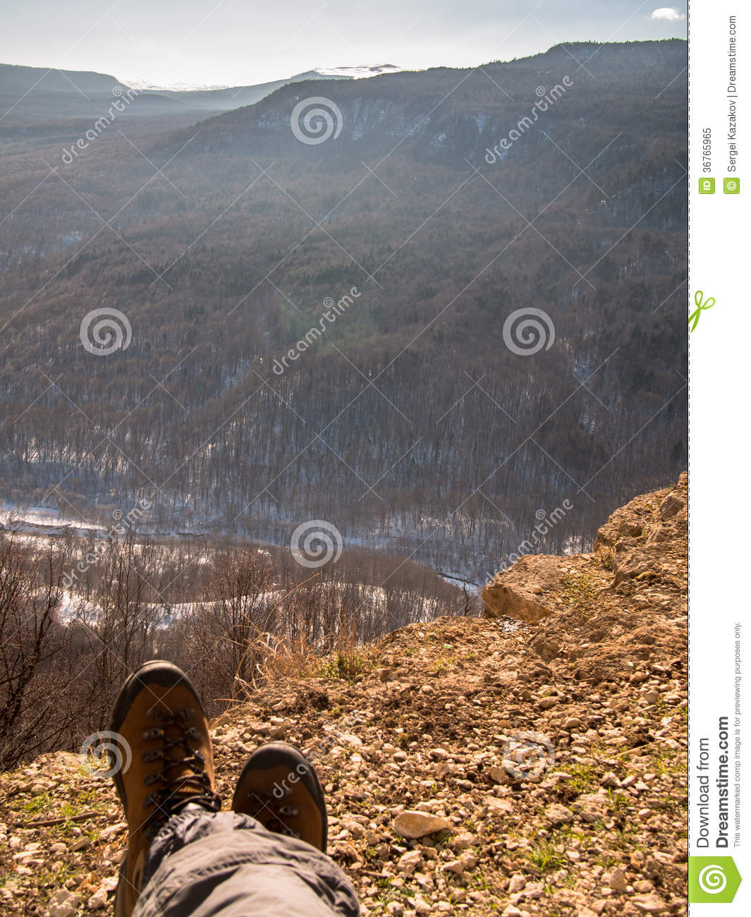 Feet In Shoes Lay On A Rock Stock Image