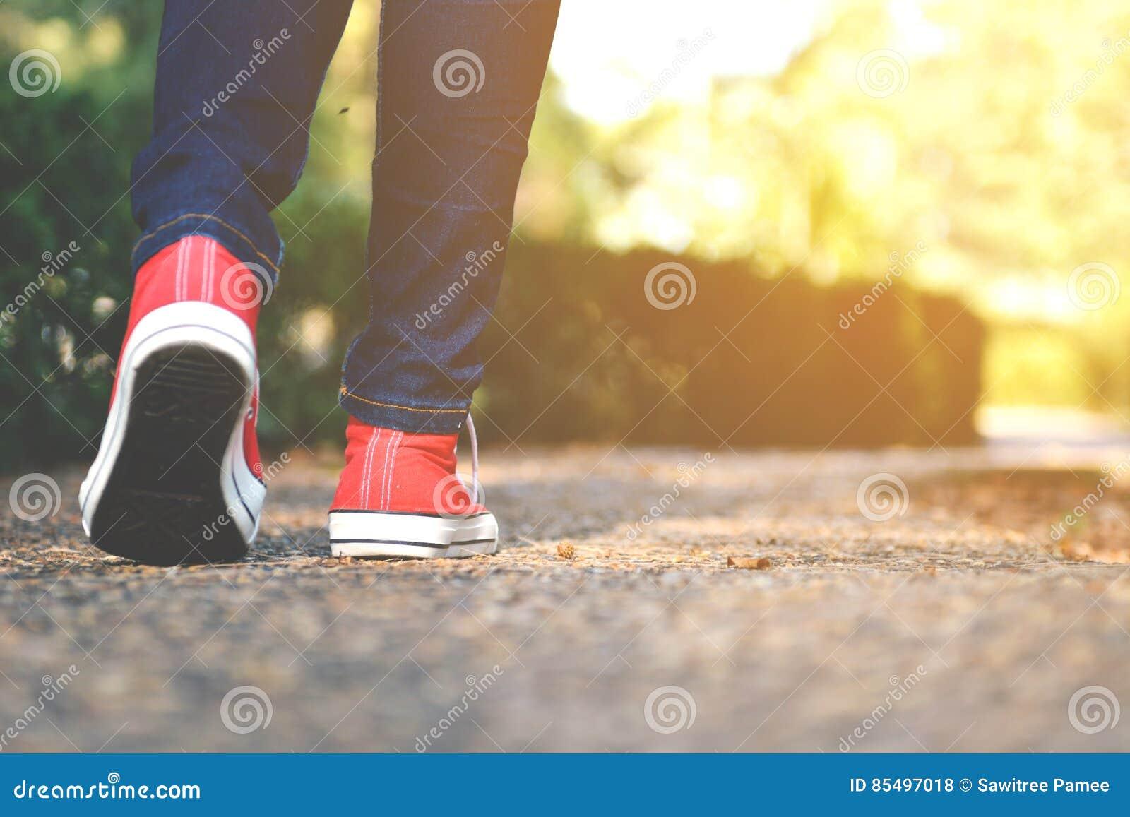 Feet women in the walking on the park