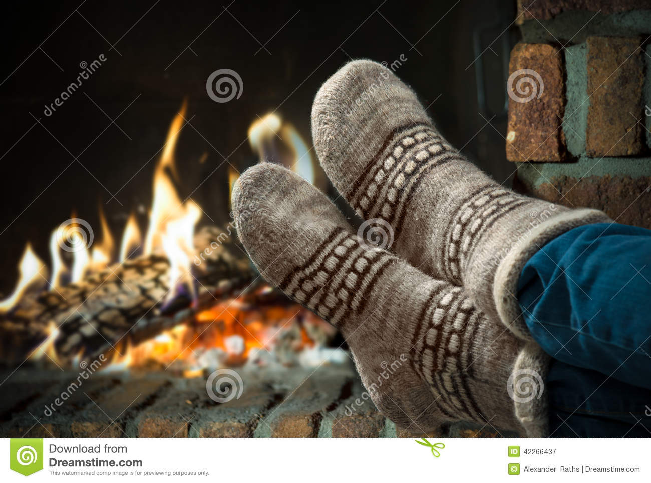 feet in wool socks warming at the fireplace stock image image