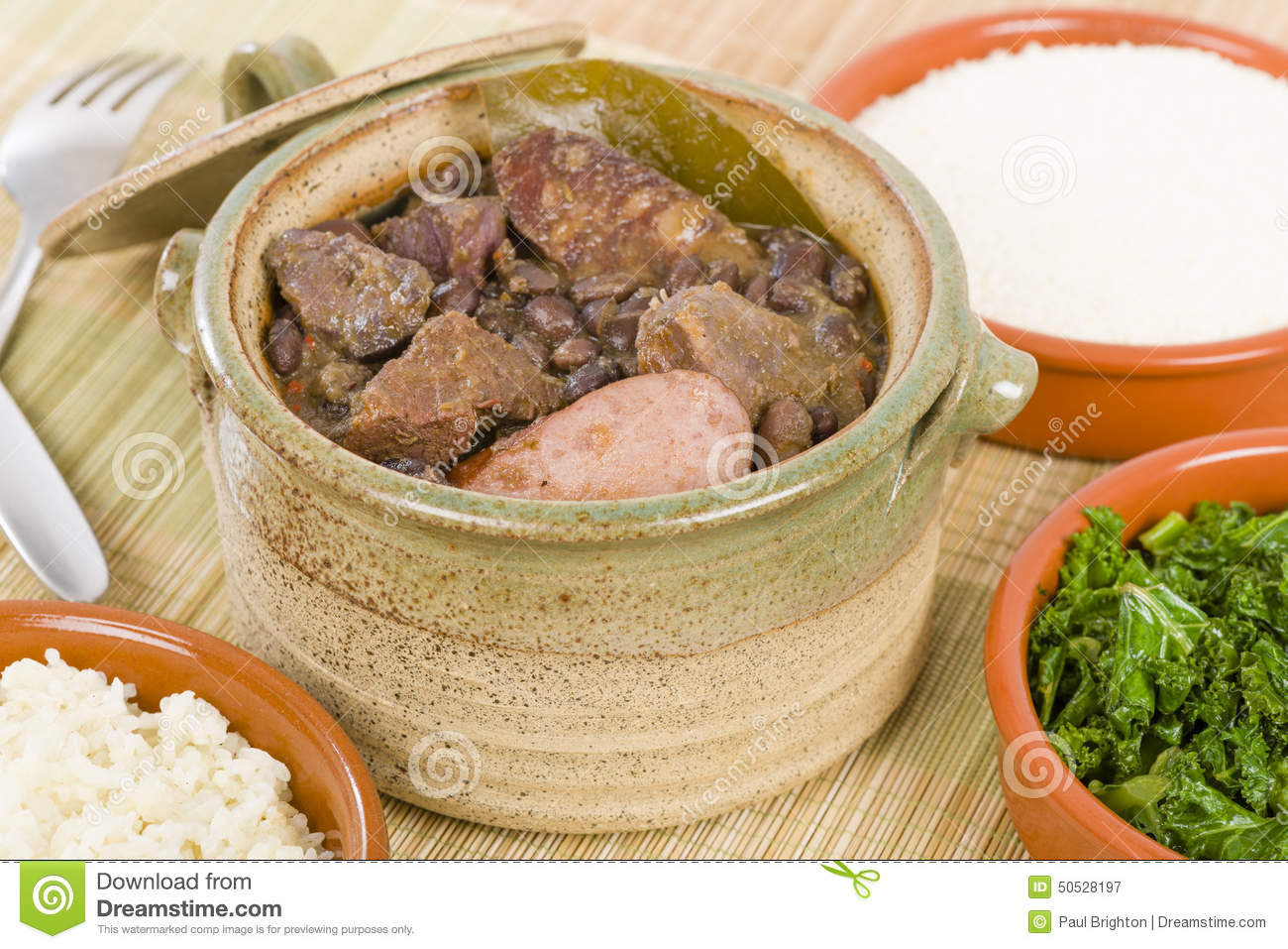 Feijoada - Brazilian beef, sausage, pork and black bean stew served ...