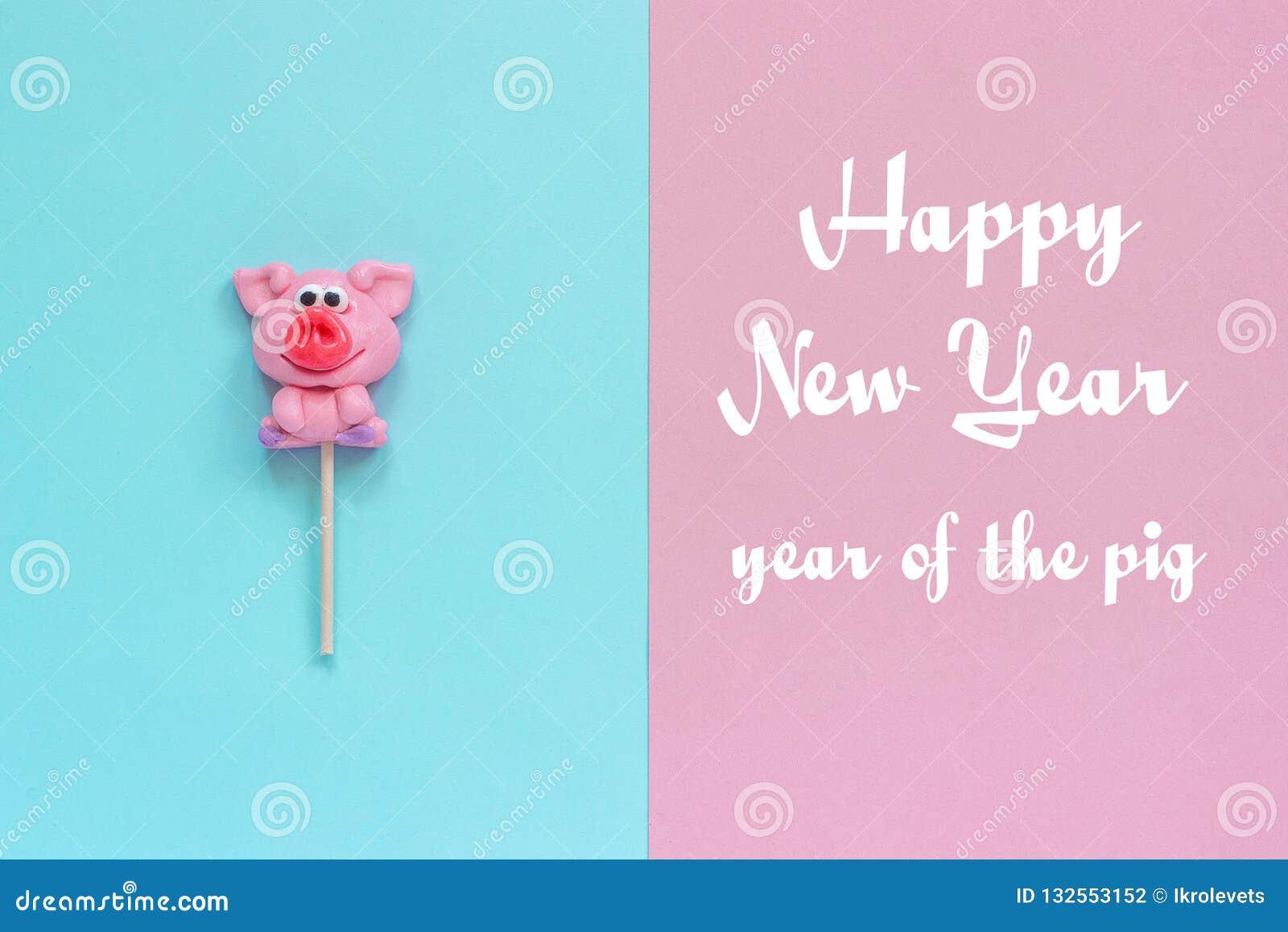 Feliz Año Nuevo de la piruleta y del texto del cerdo